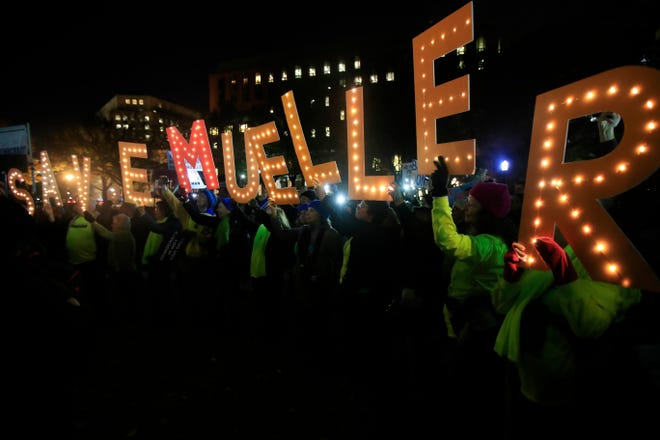 """Protesters gather and hold banners in front of the White House Thursday as part of a nationwide """"Protect Mueller"""" campaign demanding that Acting U.S. Attorney General Matthew Whitaker recuse himself from overseeing the special counsel investigation."""