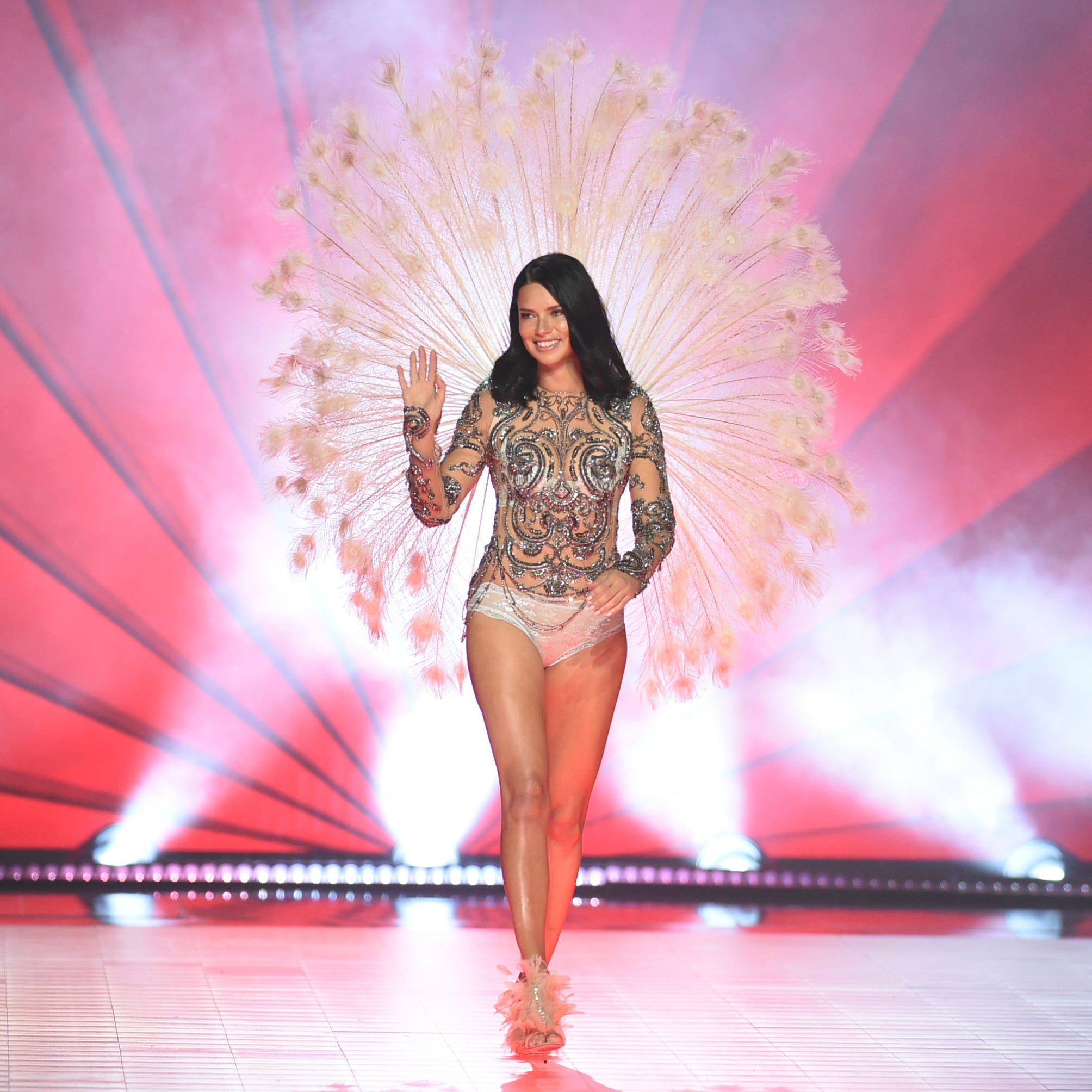 Adriana Lima waves to the audience as she walks the runway during the 2018 Victoria's Secret Fashion Show at Pier 94 on Thursday, Nov. 8, 2018, in New York. (Photo by Evan Agostini/Invision/AP) ORG XMIT: CAPM117