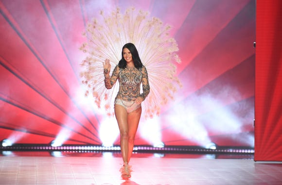 Adriana Lima waves to the audience as she walks the runway during the 2018 Victoria's Secret Fashion Show, her last for the lingerie maker.