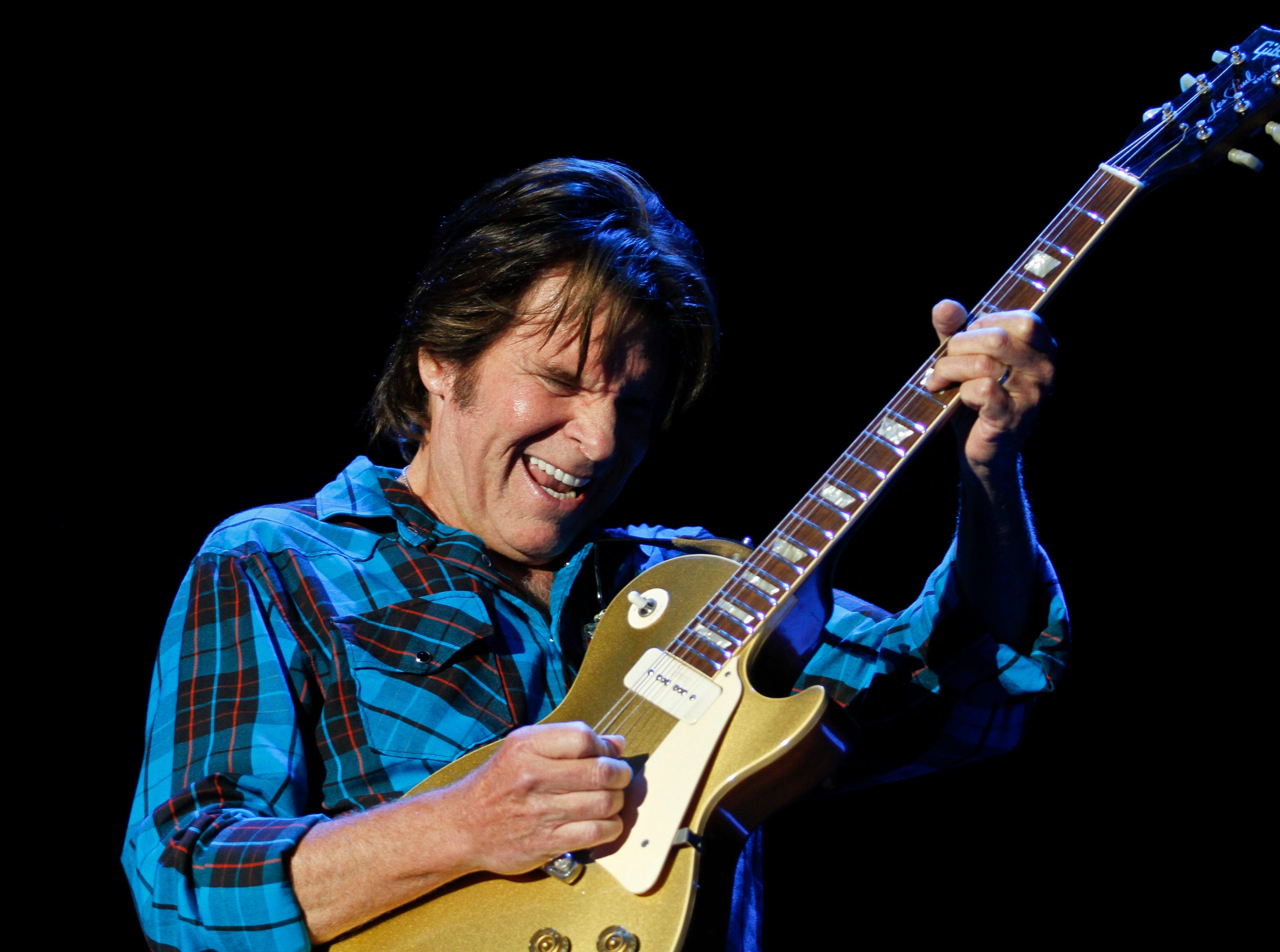 ORG XMIT: STO803 U.S. rock singer John Fogerty performs during the Peace & Love festival in Borlange in the Midwest of Sweden Saturday July 3 2010. (AP photo/Scanpix Sweden/Niklas Larsson)  ** SWEDEN OUT **