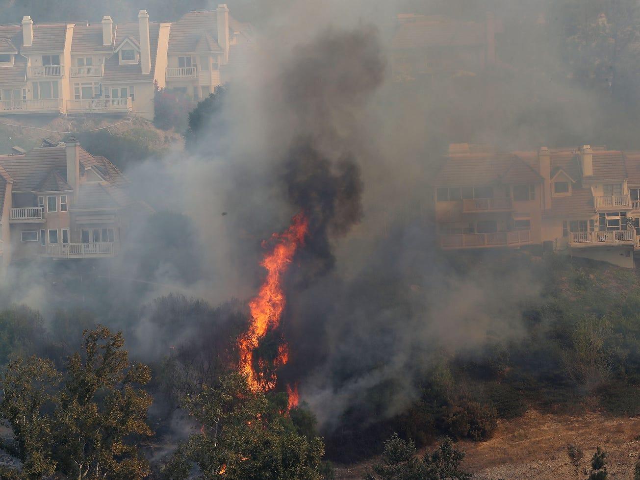 Flames from the Woolsey Fire threaten hillside homes in Westlake Village.