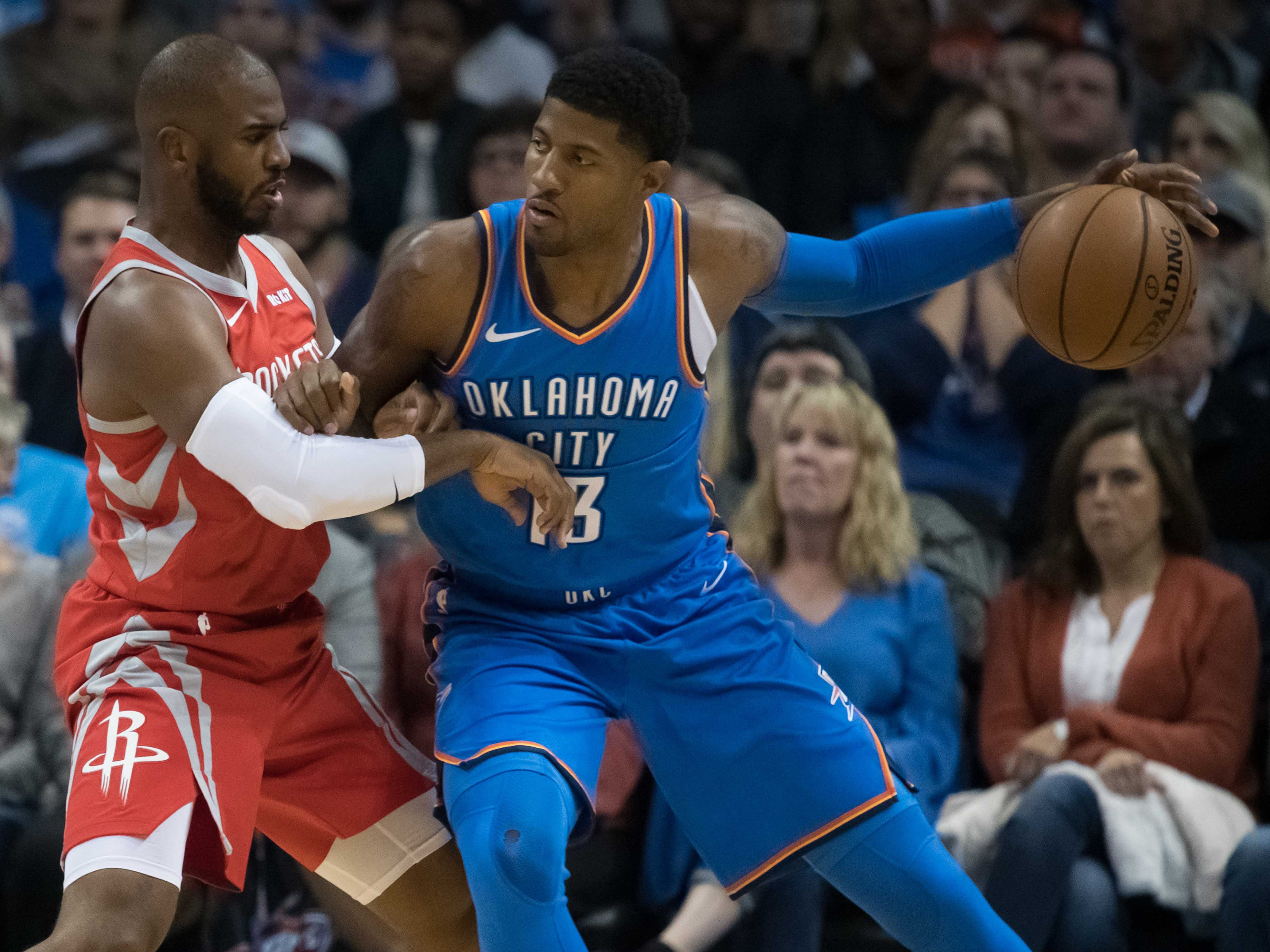 Nov. 8: Thunder forward Paul George (13) tries to back down Rockets guard Chris Paul (3) during the first half in Oklahoma City.