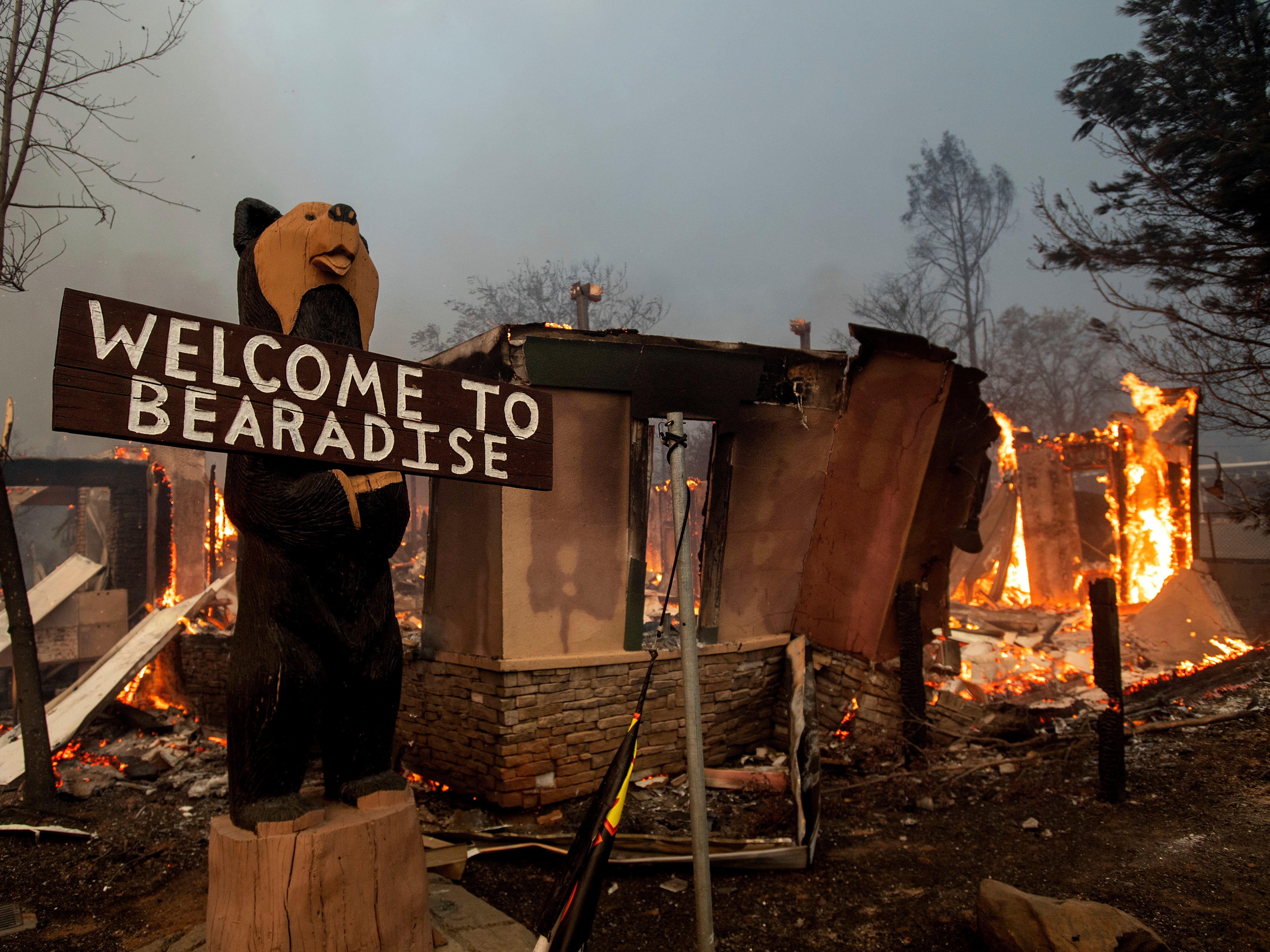 Flames consume a building as the Camp Fire tears through Paradise, Calif., on Nov. 8, 2018.