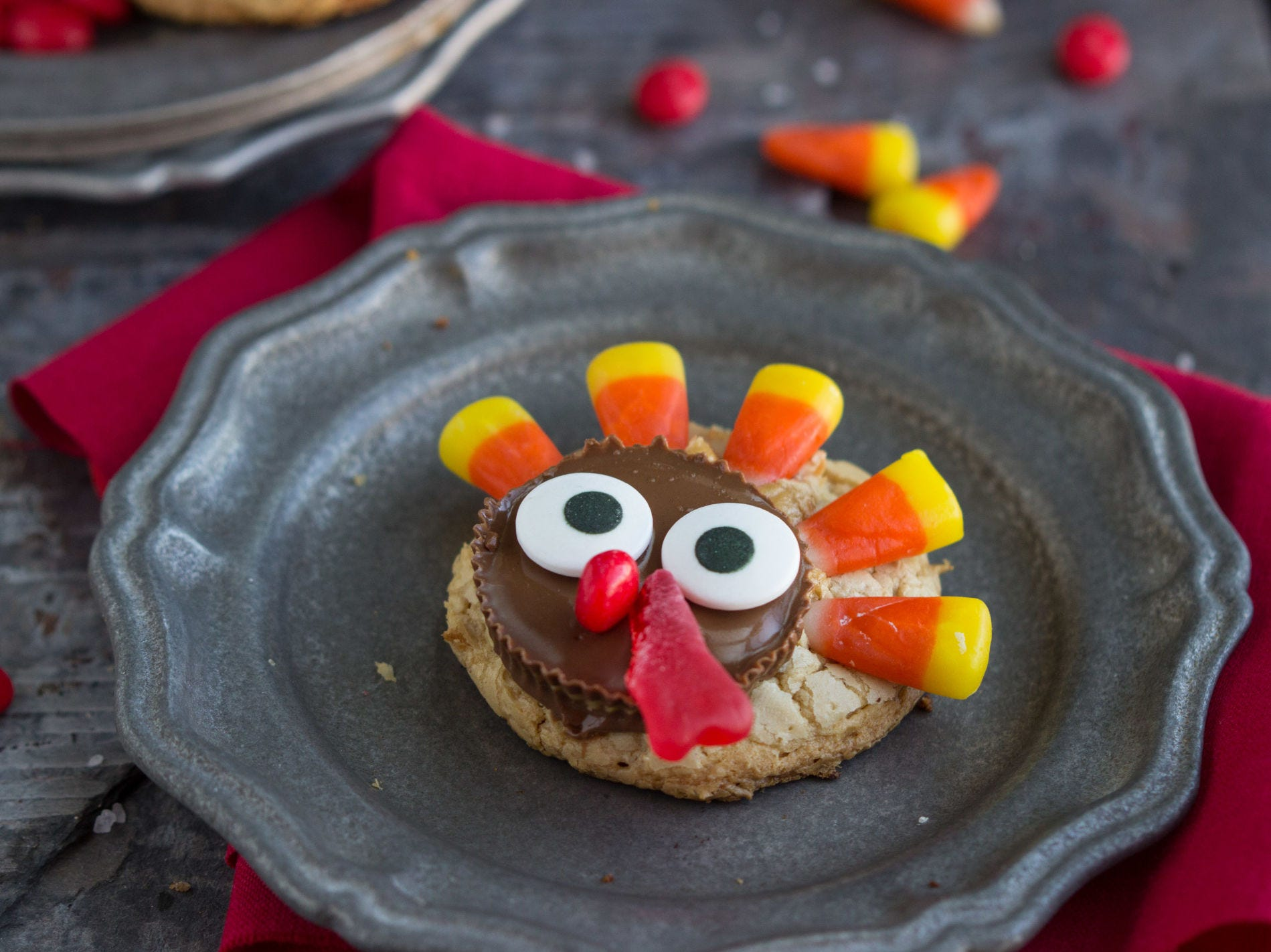 These adorable turkey-decorated peanut butter cookies will make a fun, kid-friendly Thanksgiving dessert! You can make them ahead of time to wow your Thanksgiving guests, or wait until the day-of and have the kiddos help you decorate them.