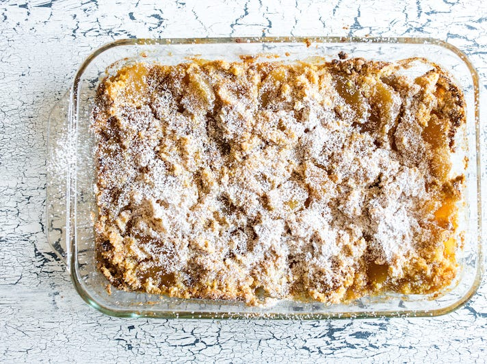 """Don't let the name of this recipe fool you — this apple pie version of the famous """"dump cake"""" is a delicious and sophisticated addition to your family gathering!"""