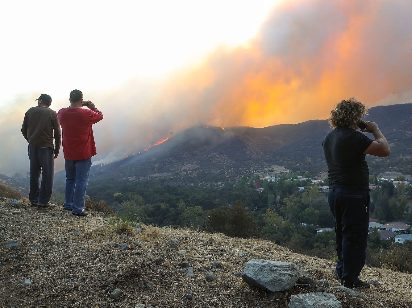 Residents of Westlake Village, Calif.. watch the Woolsey Fire on Friday.