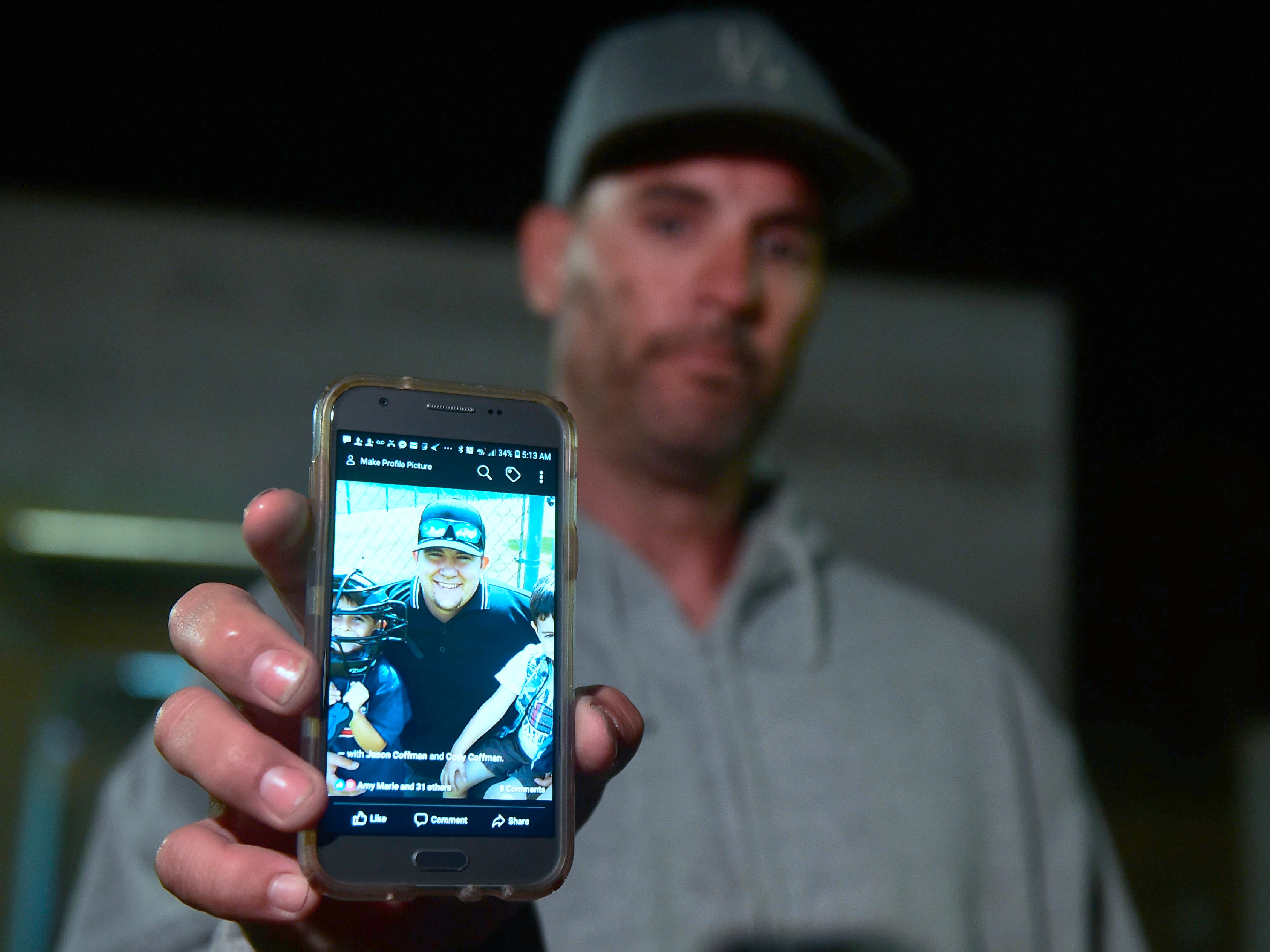 Jason Coffman displays a photo of his son Cody outside the Thousands Oaks Teene Center where he came hoping to find his son who was at the Borderline Bar and Grill in Thousand Oaks, California, on November 8, 2018. - Twelve people, including a police sergeant, were shot dead in a shooting at the bar close to Los Angeles, police said Thursday. All the victims were killed inside the bar in the suburb of Thousand Oaks late on November 7, including the officer who had been called to the scene, Sheriff Geoff Dean told reporters. The gunman was also dead at the scene, Dean added. (Photo by Frederic J. BROWN / AFP)        (Photo credit should read FREDERIC J. BROWN/AFP/Getty Images) ORG XMIT: 775256014 ORIG FILE ID: 1059133152.jpg