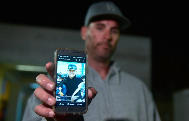 Jason Coffman displays a photo of his son Cody, 22, killed at the Borderline Bar and Grill in Thousand Oaks, California, Nov. 8, 2018.
