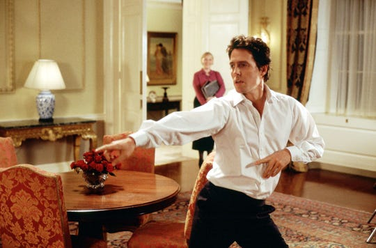 "Hugh Grant gets his groove on in the holiday classic ""Love Actually."""