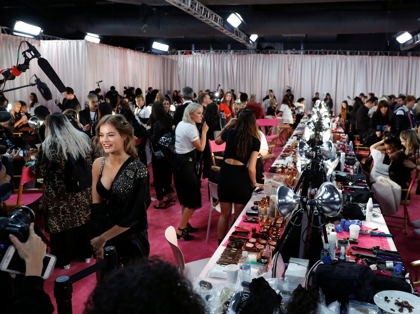 A Victoria's Secret model gives an interview  during hair and make-up sessions before the start of the Victoria's Secret fashion event.