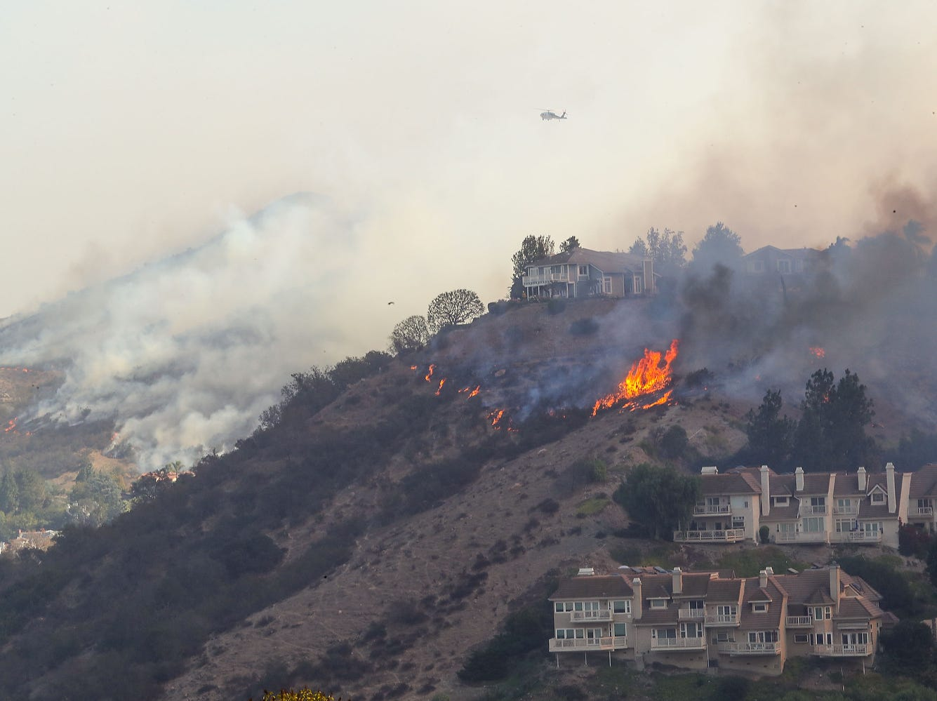 The Woolsey Fire threatens hillside homes in Westlake Village, Calif.