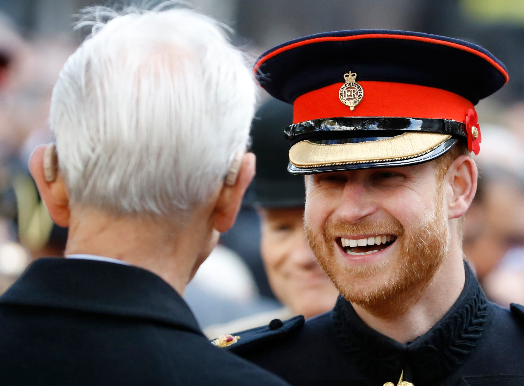 Britain's Prince Harry smiles as he talks to servicemen and veterans as he attends the annual Field of Remembrance service at Westminster Abbey in London, Thursday, Nov. 8, 2018. The centenary of the end of hostilities in WWI will be marked with large commemoration services in London, Paris and on the battlefields of northern France, on Sunday Nov. 11. (AP Photo/Alastair Grant) ORG XMIT: XAG114