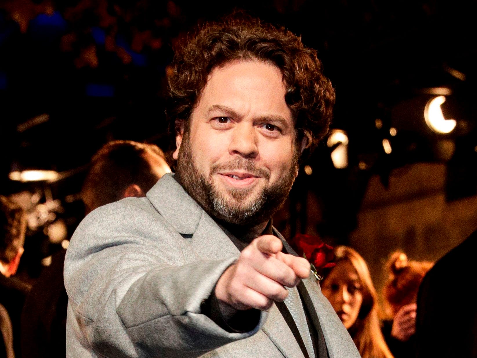 US actor Dan Fogler reacts for photographers as he arrives for the premier of the fantasy film 'Fantastic Beasts: The Crimes of Grindelwald' in Paris on November 8, 2018. (Photo by Geoffroy VAN DER HASSELT / AFP)GEOFFROY VAN DER HASSELT/AFP/Getty Images ORIG FILE ID: AFP_1AO8R3