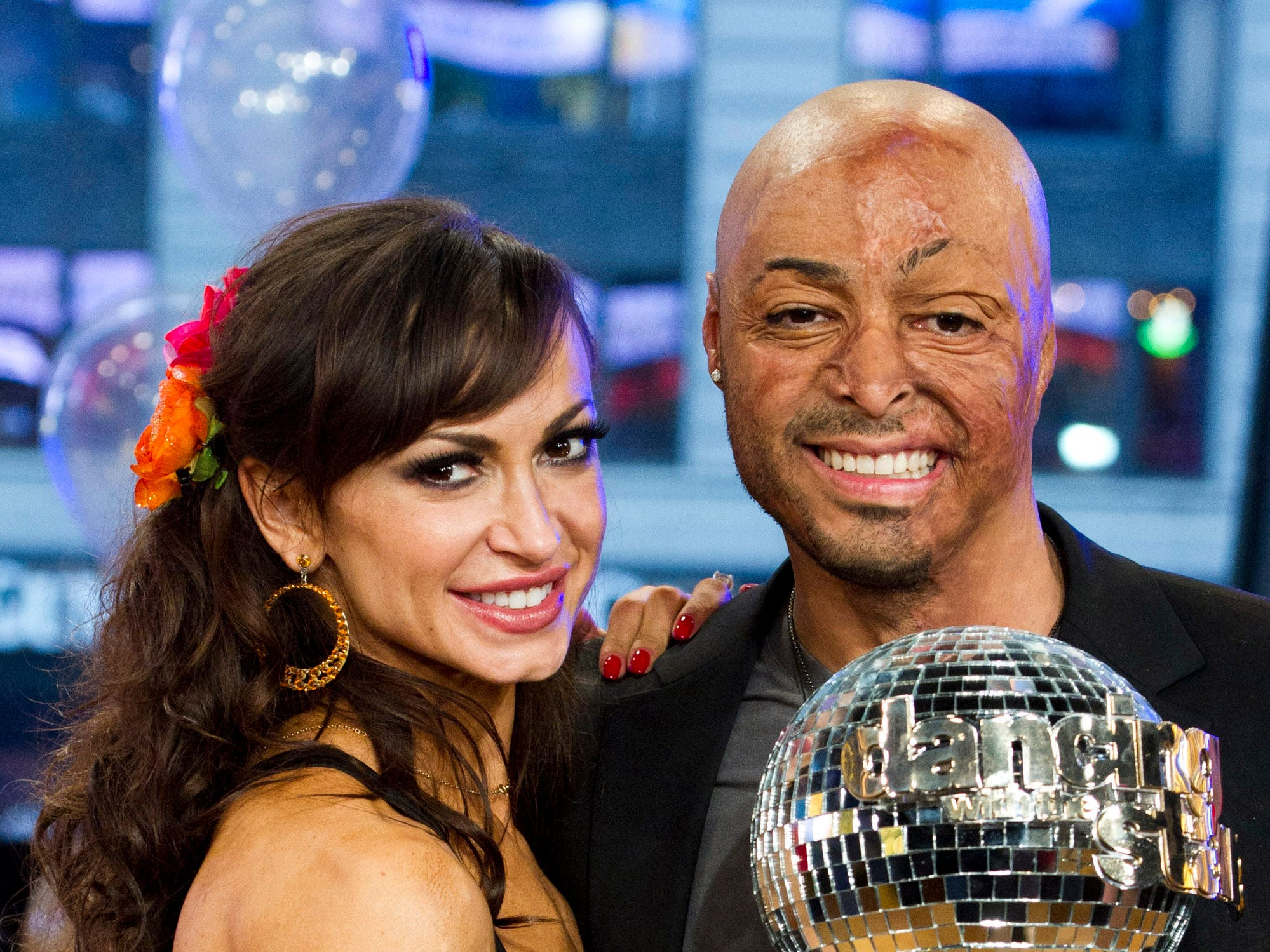 "ORG XMIT: NYCS300 Karina Smirnoff, left, and J.R. Martinez winners of the ""Dancing with the Stars"" celebrity dance competition, appear on ""Good Morning America"" in New York, Wednesday, Nov. 23, 2011. (AP Photo/Charles Sykes)"