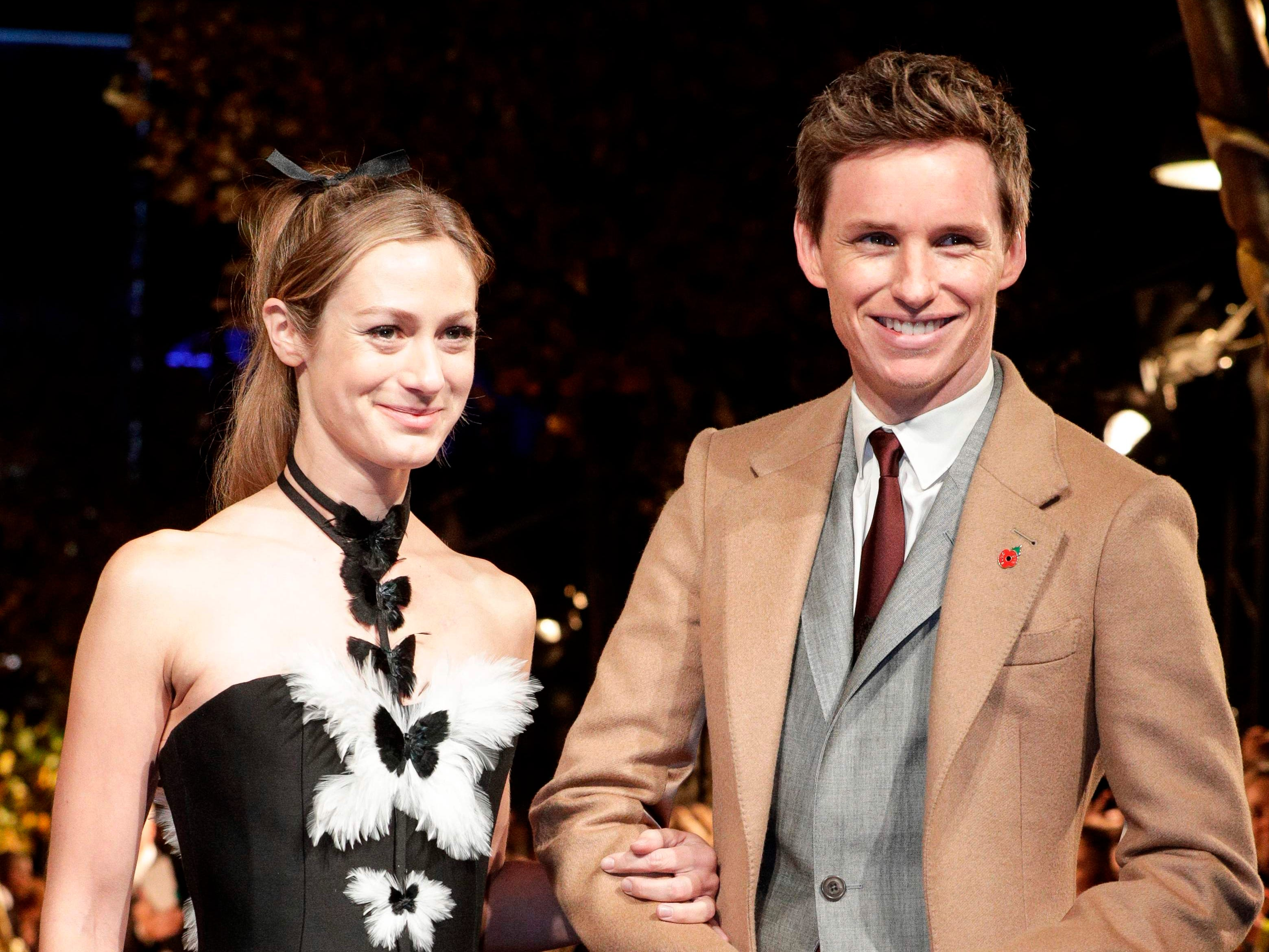 British actor Eddie Redmayne and his wife Hannah Bagshawe arrive for the premier of the fantasy film 'Fantastic Beasts: The Crimes of Grindelwald' in Paris on November 8, 2018. (Photo by Geoffroy VAN DER HASSELT / AFP)GEOFFROY VAN DER HASSELT/AFP/Getty Images ORIG FILE ID: AFP_1AO8SY