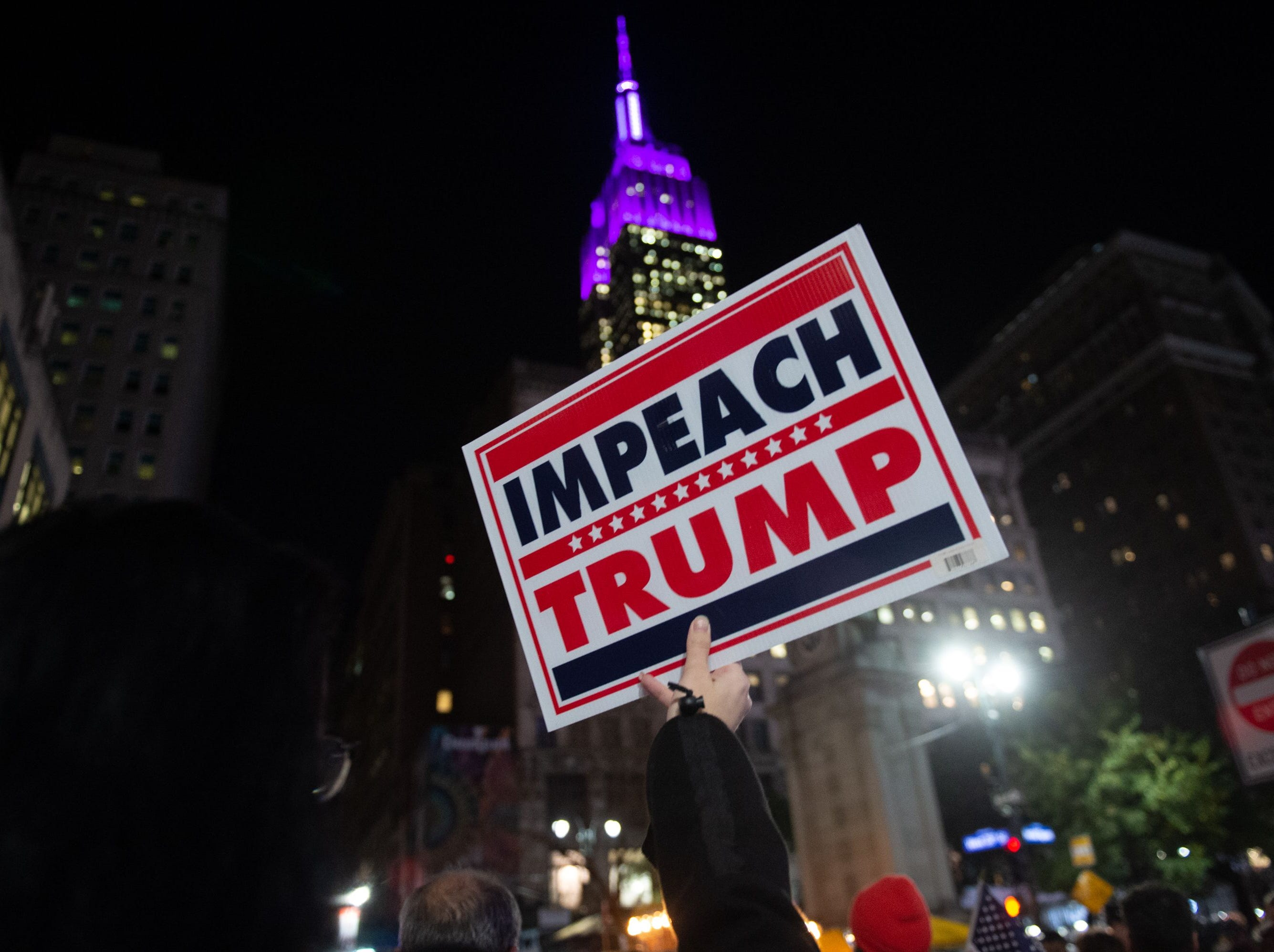 People protest and march against US President Donald Trump's alleged interference in Robert Mueller investigation in New York City on November 8, 2018. - President Donald Trump was accused on November 8, 2018, of pushing America toward a constitutional crisis after his firing of the attorney general cast doubt over the future of an explosive probe into election collusion with Russian agents.