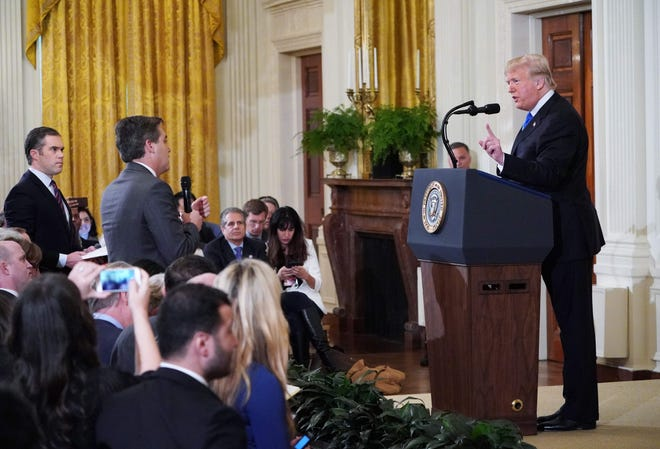 President Donald Trump argues with CNN's Jim Acosta.