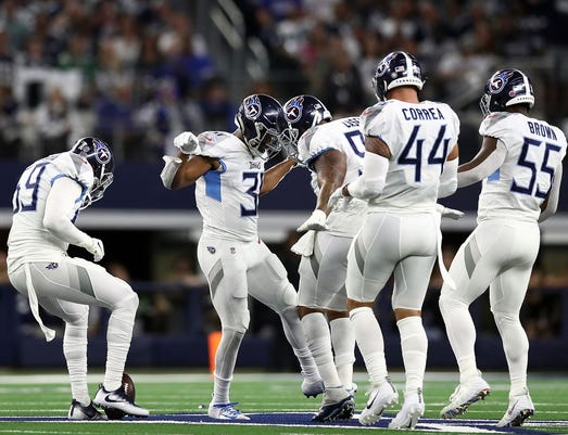 4b77e34f2 Gty 1057848928 S Fbn Spo Usa Tx. Tennessee Titans players celebrate a first  quarter interception by Kevin Byard ...