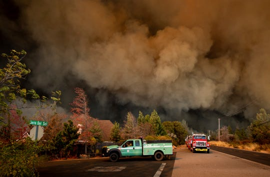 The Camp Fire rages through Paradise, Calif., on Thursday, Nov. 8, 2018. Tens of thousands of people fled a fast-moving wildfire Thursday in Northern California, some clutching babies and pets as they abandoned vehicles and struck out on foot ahead of the flames that forced the evacuation of an entire town.