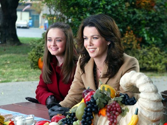 "Rory (Alexis Bledel"" and Lorelai (Lauren Graham) try to attend four Thanksgiving dinners on the ""Gilmore Girls"" episode, ""A Deep-Fried Korean Thanksgiving."""