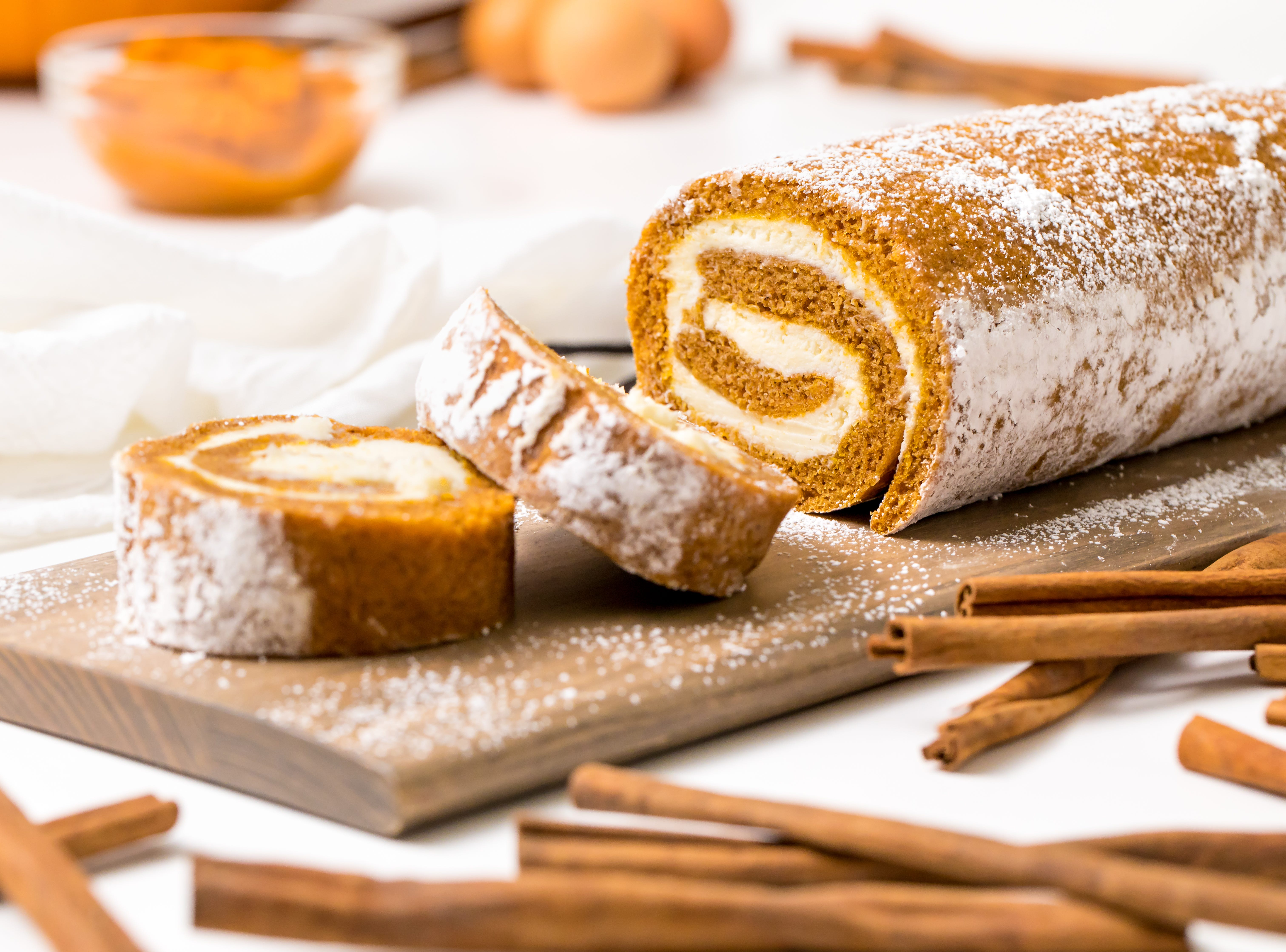 When your sweet tooth is yearning for a scrumptious fall-inspired dessert for the holidays, bake this pumpkin roll, inspired by That Skinny Chick Can Bake, and enjoy bite after bite of warmly spiced pumpkin cake spiraled with a dreamy cream cheese filling.