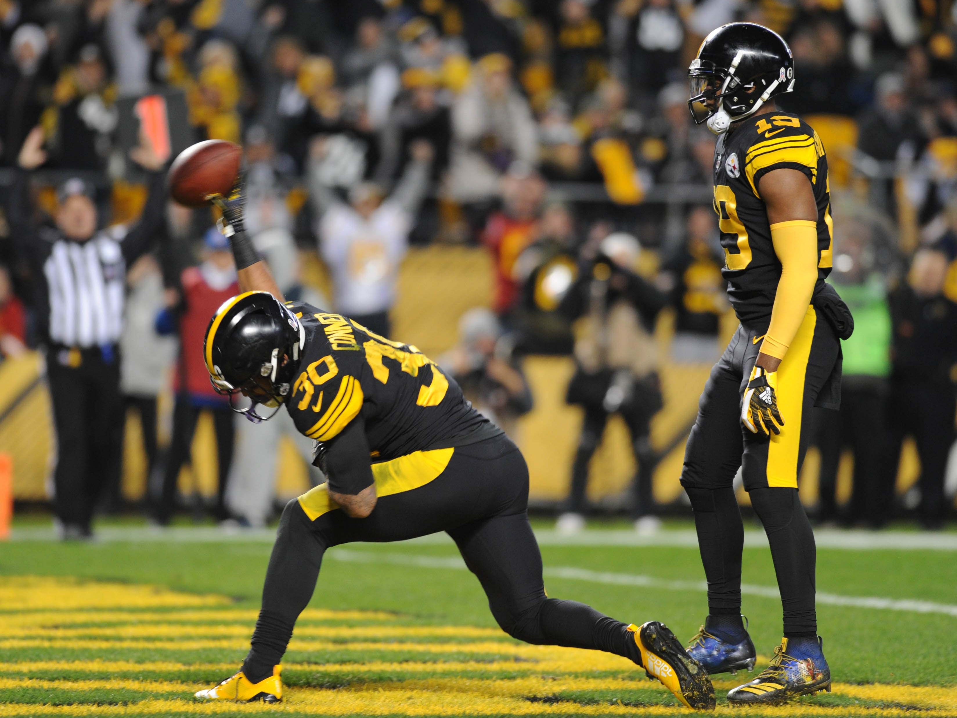 Pittsburgh Steelers running back  James Conner celebrates a touchdown against the Carolina Panthers at Heinz Field. The Steelers won the game, 52-21.