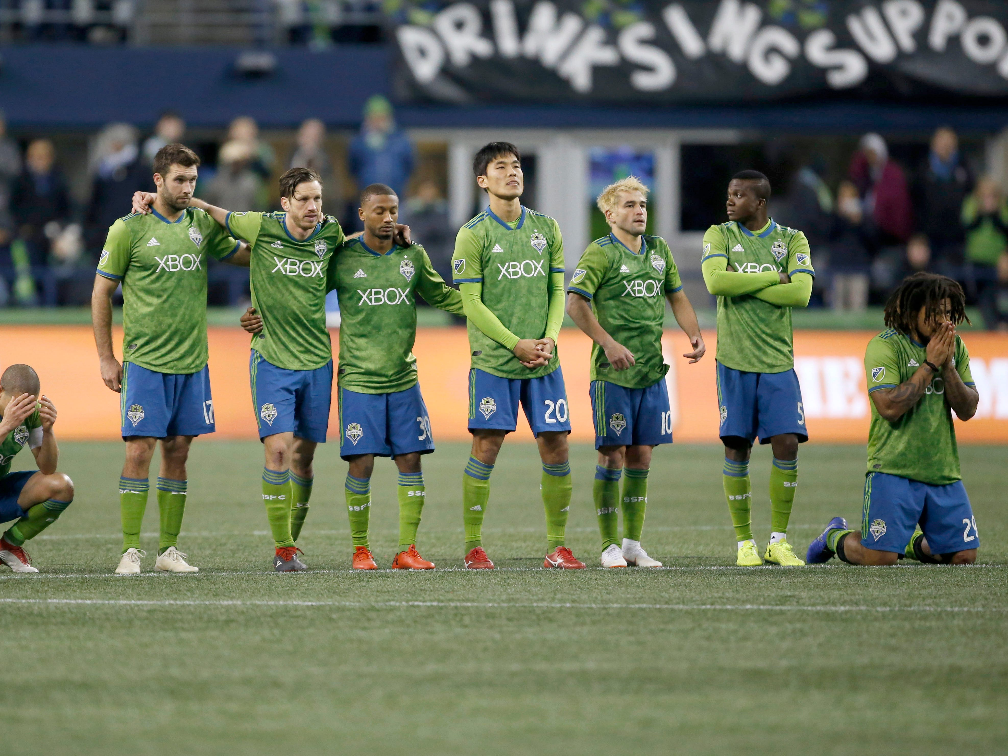 The Seattle Sounders FC react during penalty kicks against the Portland Timbers at CenturyLink Field.