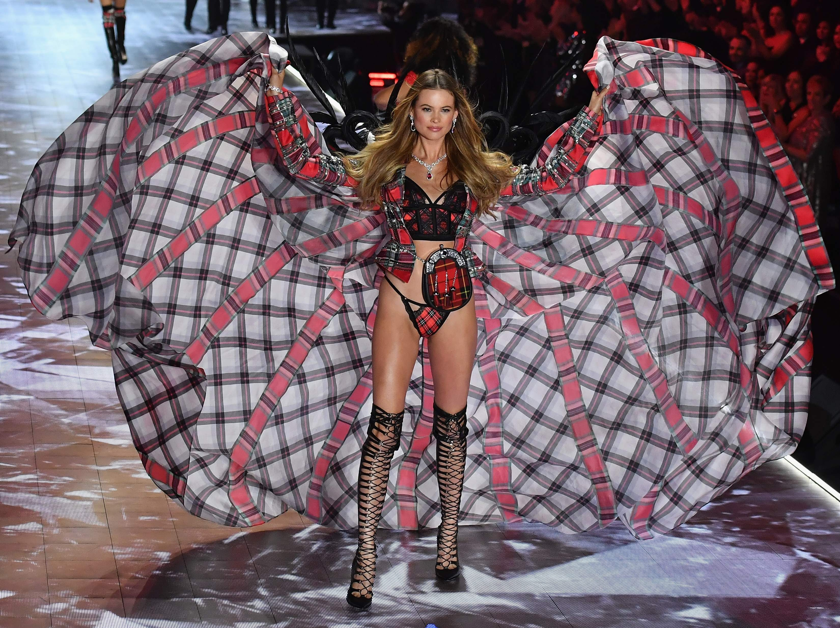 Namibian Model Behati Prinsloo walks the runway at the 2018 Victoria's Secret Fashion Show on November 8, 2018 at Pier 94 in New York City. - Every year, the Victoria's Secret show brings its famous models together for what is consistently a glittery catwalk extravaganza. It's the most-watched fashion event of the year (800 million tune in annually) with around 12 million USD spent on putting the spectacle together according to Harper's Bazaar. (Photo by Angela Weiss / AFP)ANGELA WEISS/AFP/Getty Images ORIG FILE ID: AFP_1AP07E