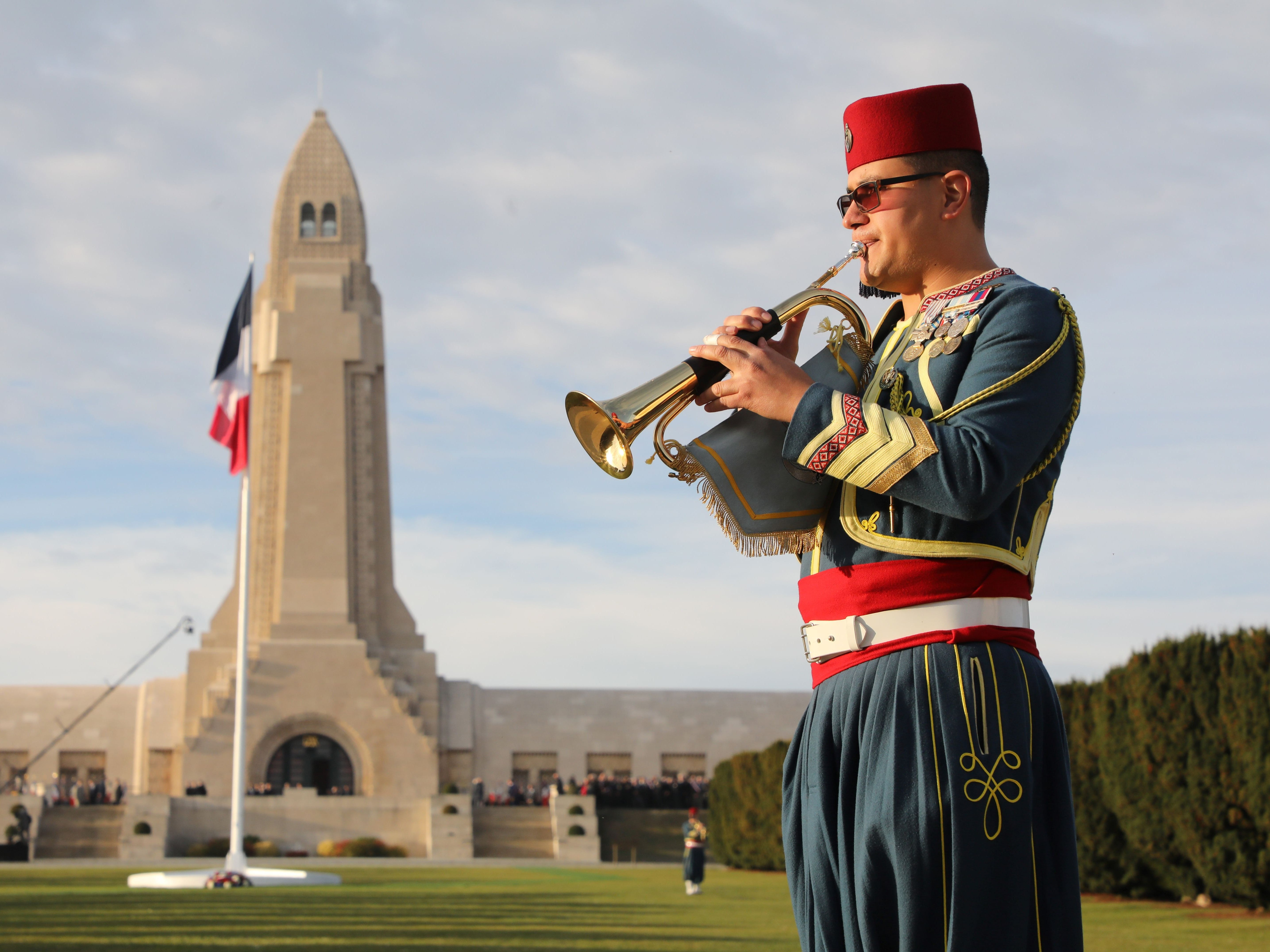 A musician dressed as a Zouave plays trumpet on November 6, 2018 at the Ossuary of Douaumont near Verdun, northeastern France, during ceremonies marking the centenary of the First World War. - The French President kicked off a week of commemorations for the 100th anniversary of the end of World War One, which is set to mix remembrance of the past and warnings about the present surge in nationalism around the globe. (Photo by ludovic MARIN / various sources / AFP)LUDOVIC MARIN/AFP/Getty Images ORIG FILE ID: AFP_1AM31M