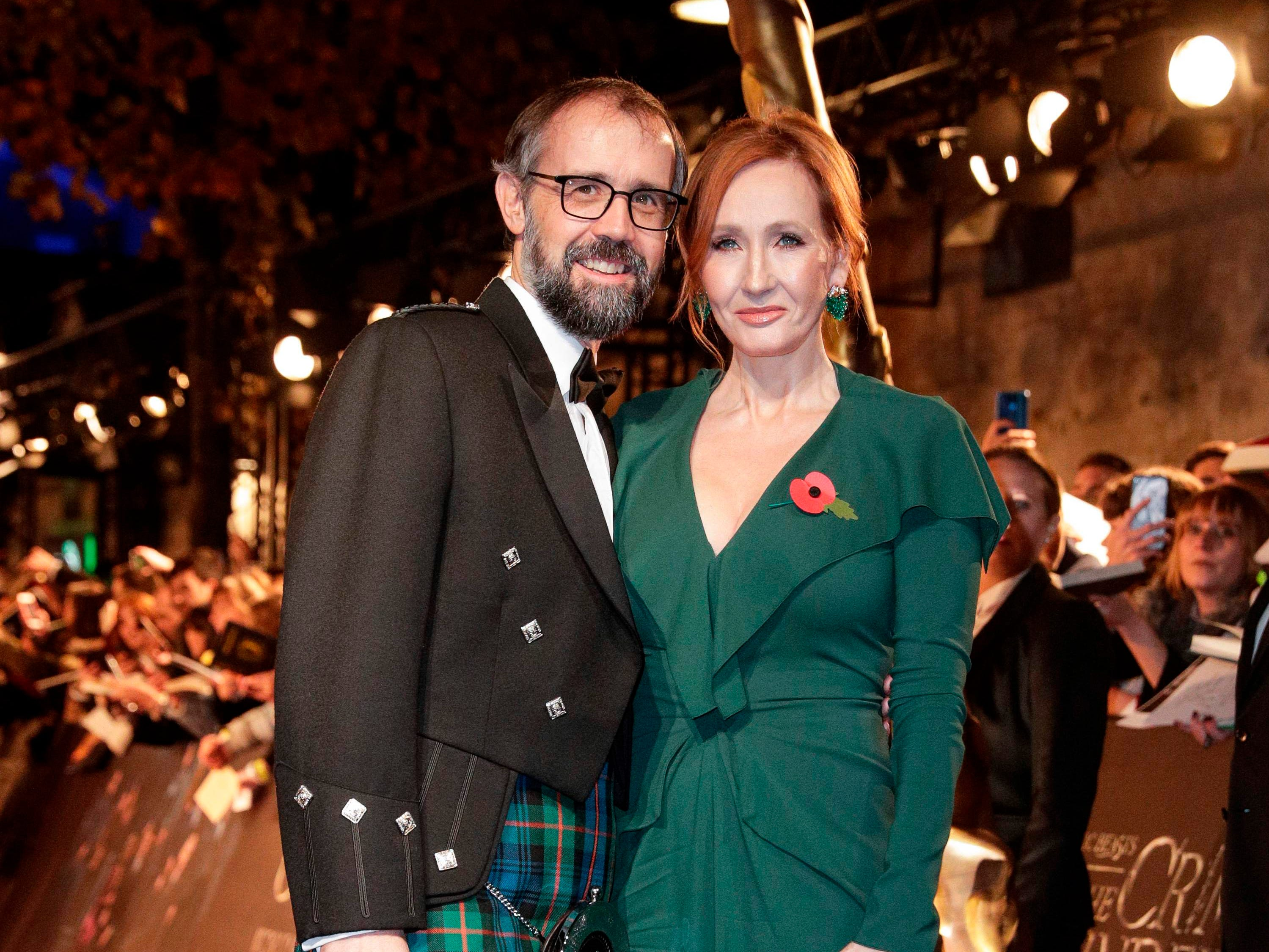 British screenplay writer J. K. Rowling poses with her husband Neil Murray for a photograph as they arrive for the premier of the fantasy film 'Fantastic Beasts: The Crimes of Grindelwald' in Paris on November 8, 2018. (Photo by Geoffroy VAN DER HASSELT / AFP)GEOFFROY VAN DER HASSELT/AFP/Getty Images ORIG FILE ID: AFP_1AO8RM