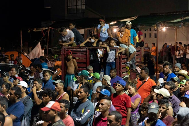 The thousands of Central American migrants traveling in a caravan that President Donald Trump wants to stop at the U.S. border began arriving in the city of Juchitan de Zaragoza before dawn on Oct. 30, 2018, in the state of Oaxaca in southern Mexico.