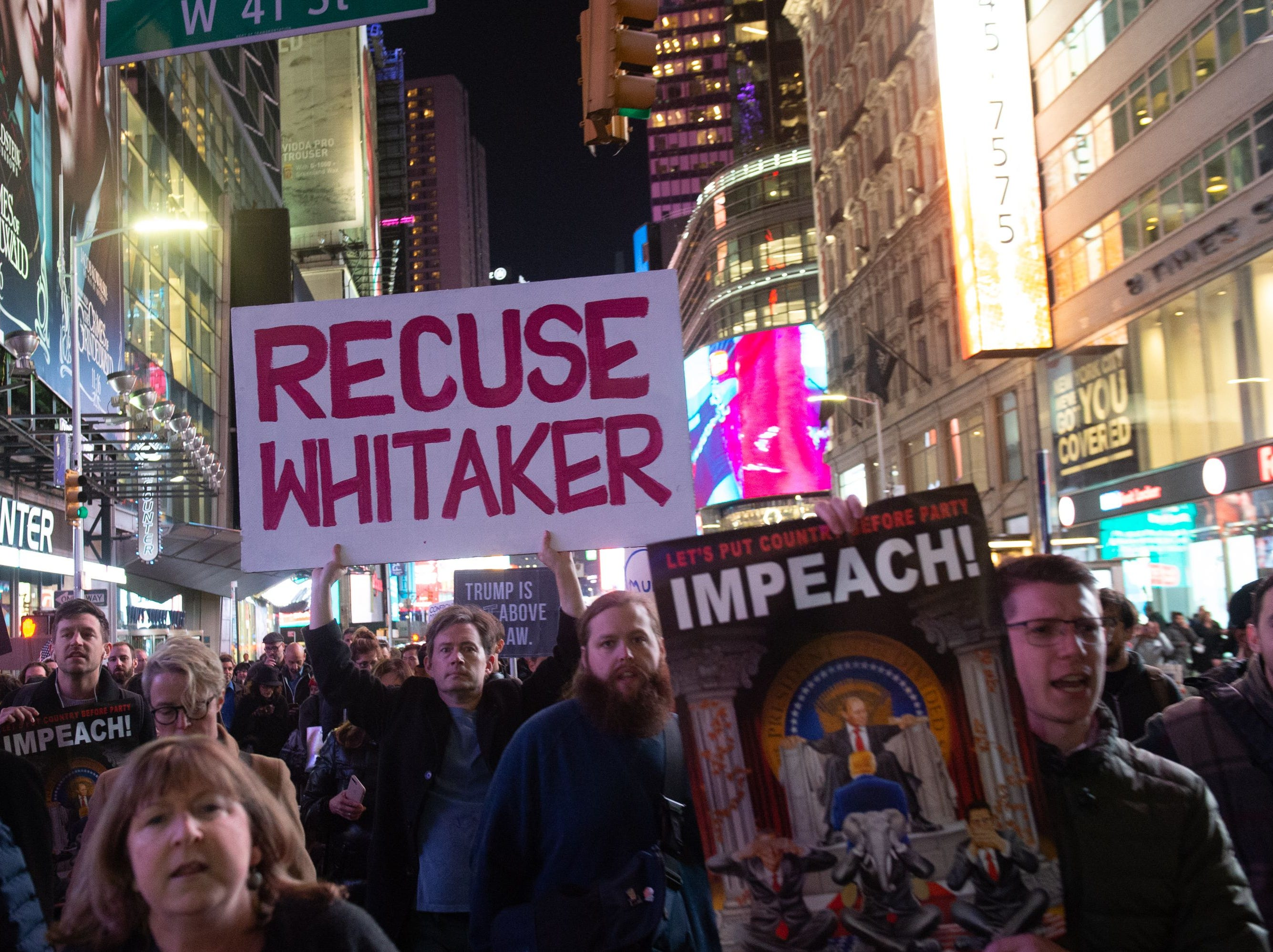 People protest and march against US President Donald Trump's alleged interference in Robert Mueller investigation in New York City on November 8, 2018.