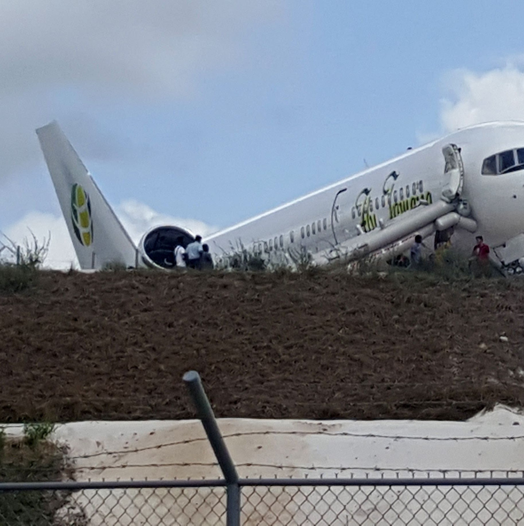 A Toronto-bound Fly Jamaica airplane is seen after crash-landing at the Cheddi Jagan International Airport in Georgetown, Guyana on Nov. 9, 2018.