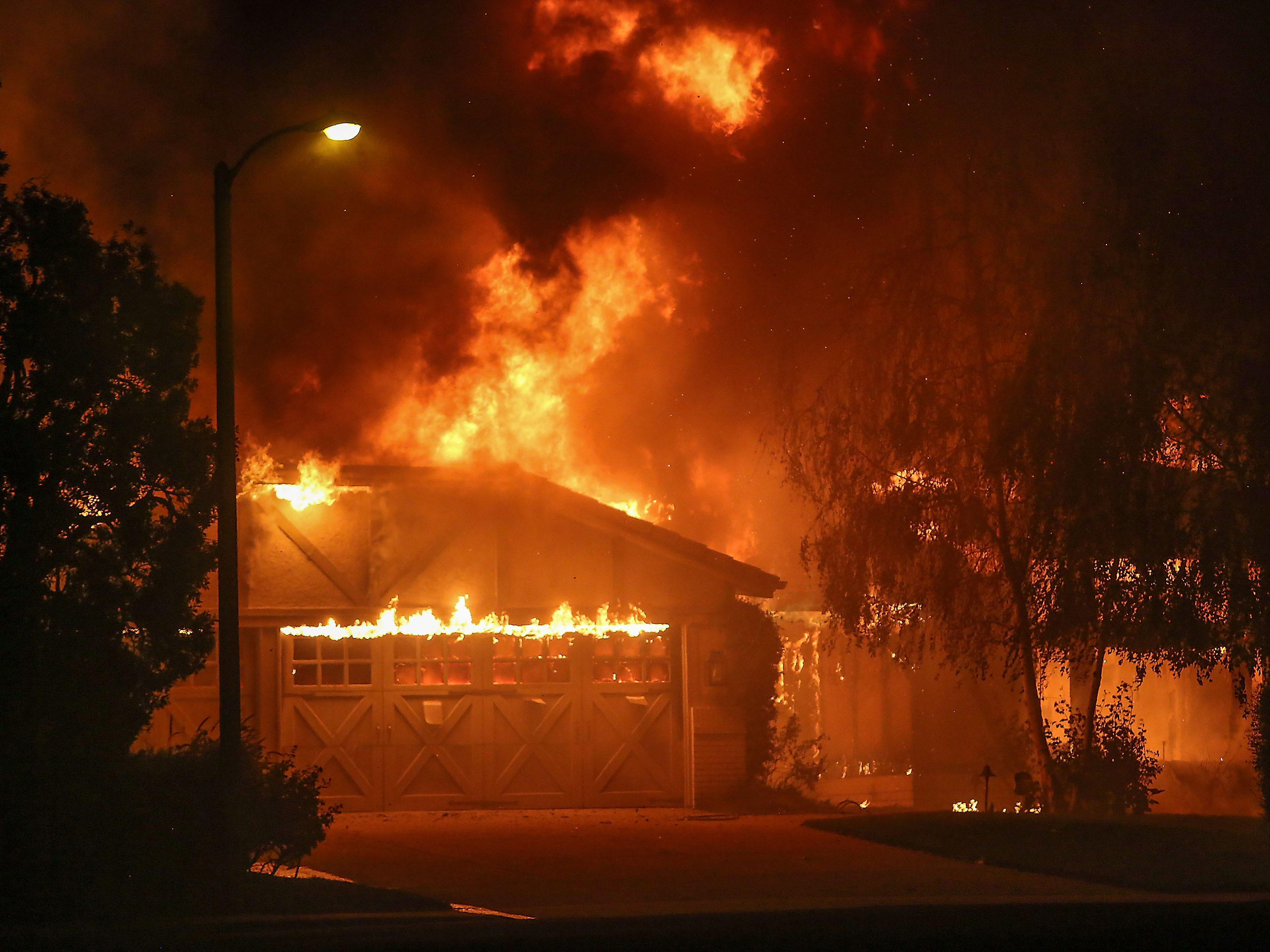 The Woolsey Fire burns a home on Lafitte Dr. in Oak Park, November 9, 2018. (Via OlyDrop)