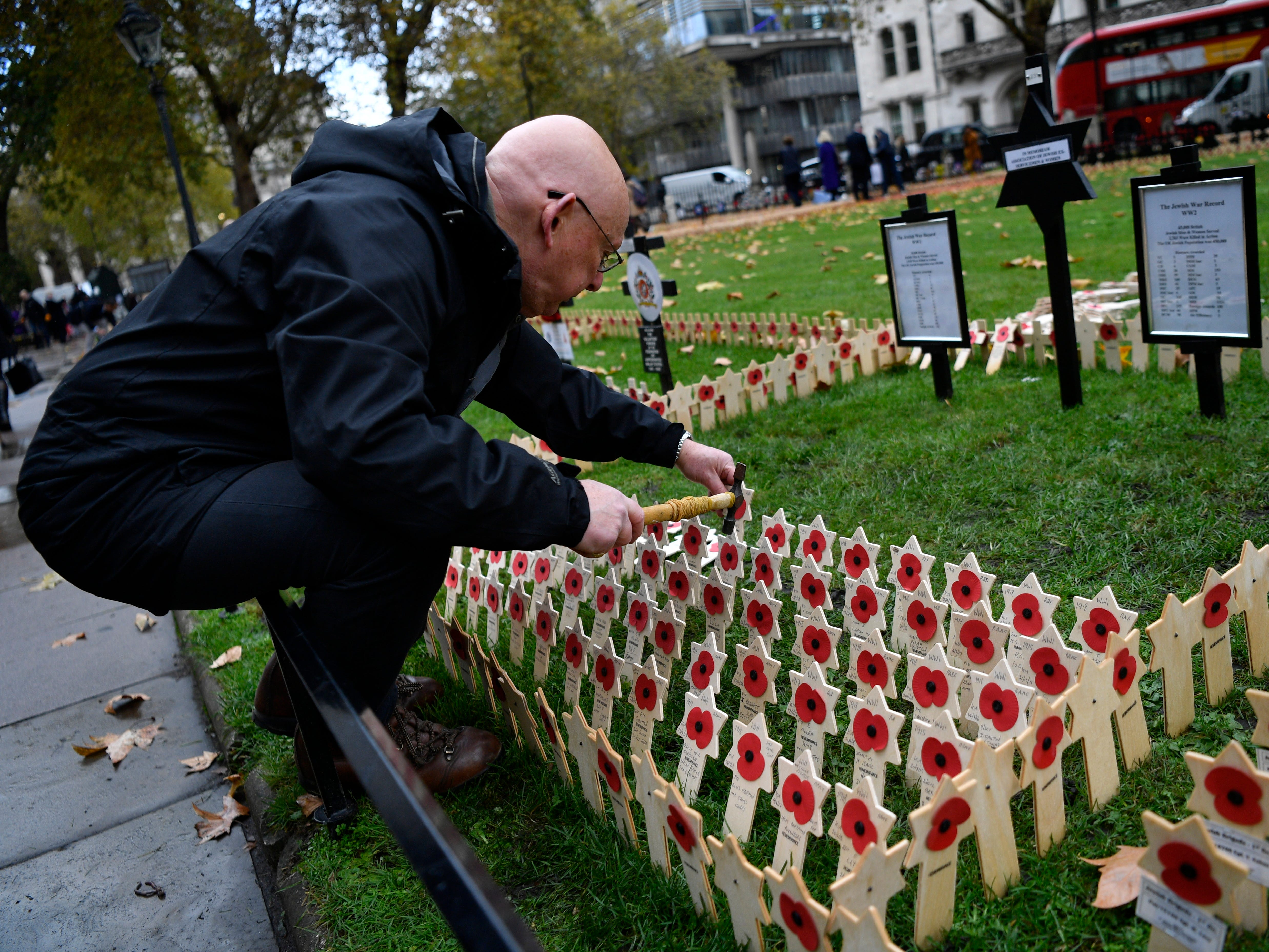 epa07148219 A man places a tribute at Westminster Abbey's Field of Remembrance in central London, Britain, 07 November 2018. The tributes marks Armistice Day ahead of the 100th anniversary of WWI Armistice Day on 11 November. Reports state that on 08 November  The Duke of Edinburgh will open The Royal British Legion Field of Remembrance at Westminster Abbey. The scarlet poppies on Remembrance Crosses are laid out by the Poppy Factory in over 230 plots for Regimental and other Associations.  EPA-EFE/NEIL HALL ORG XMIT: NGH15