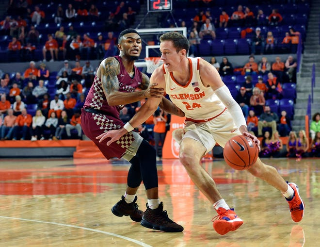 Clemson's Davis Skara drives against North Carolina Central's Reggie Gardner Jr., during the first half of an NCAA college basketball game Friday night in Clemson.