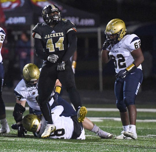 TL Hanna junior Cameron Chandler (44) celebrates sacking Spartanburg's Zay Foster (18) during the fourth quarter at TL Hanna High School in Anderson on Friday, November 9, 2018.