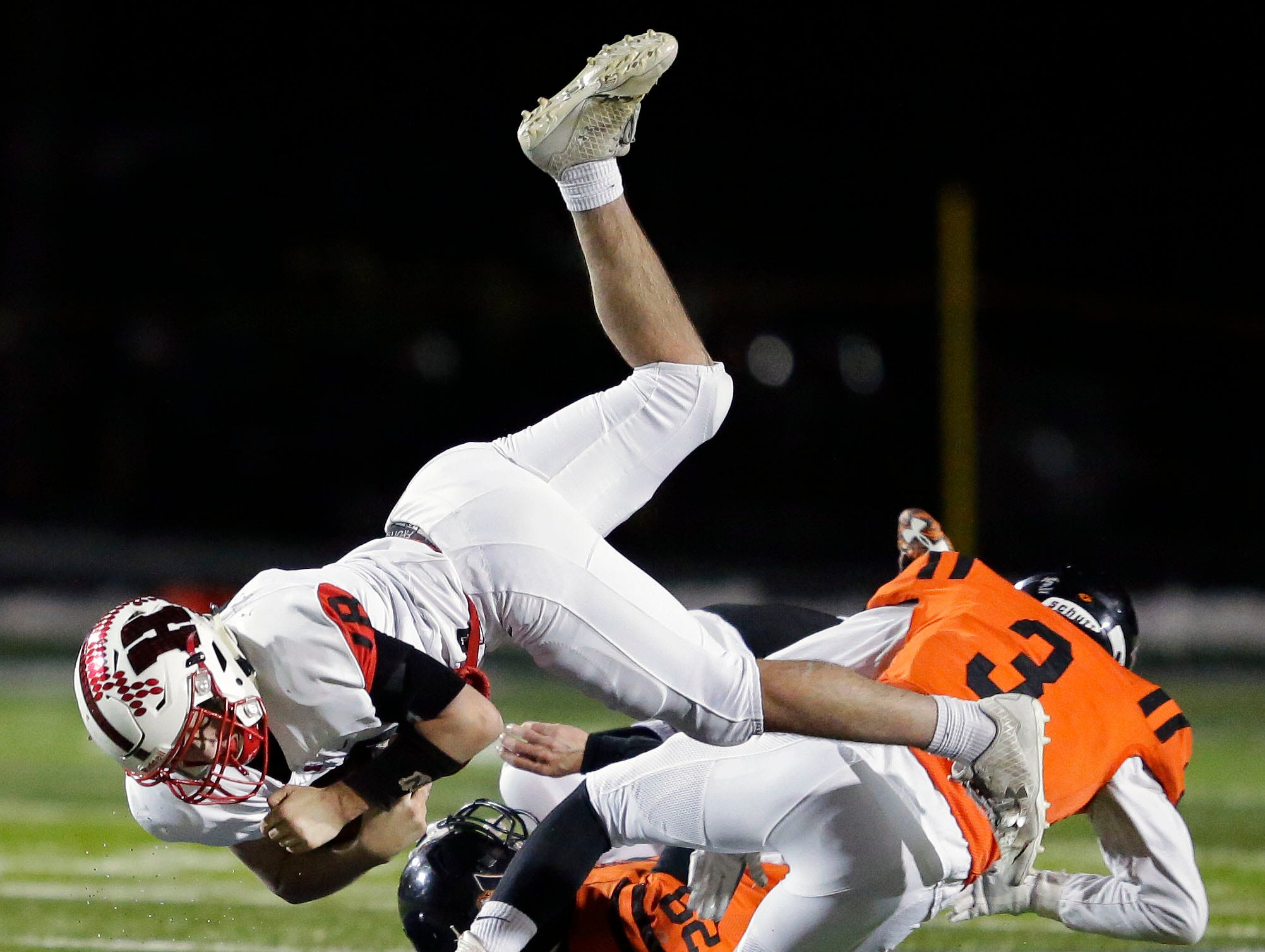 Emory Weeden of Homestead is tackled by Emmett Meissner and Nolan Hertel of Marshfield in a WIAA Division 2 state semifinal football game Friday, November 9, 2018, at Calder Stadium in Menasha, Wis.Ron Page/USA TODAY NETWORK-Wisconsin