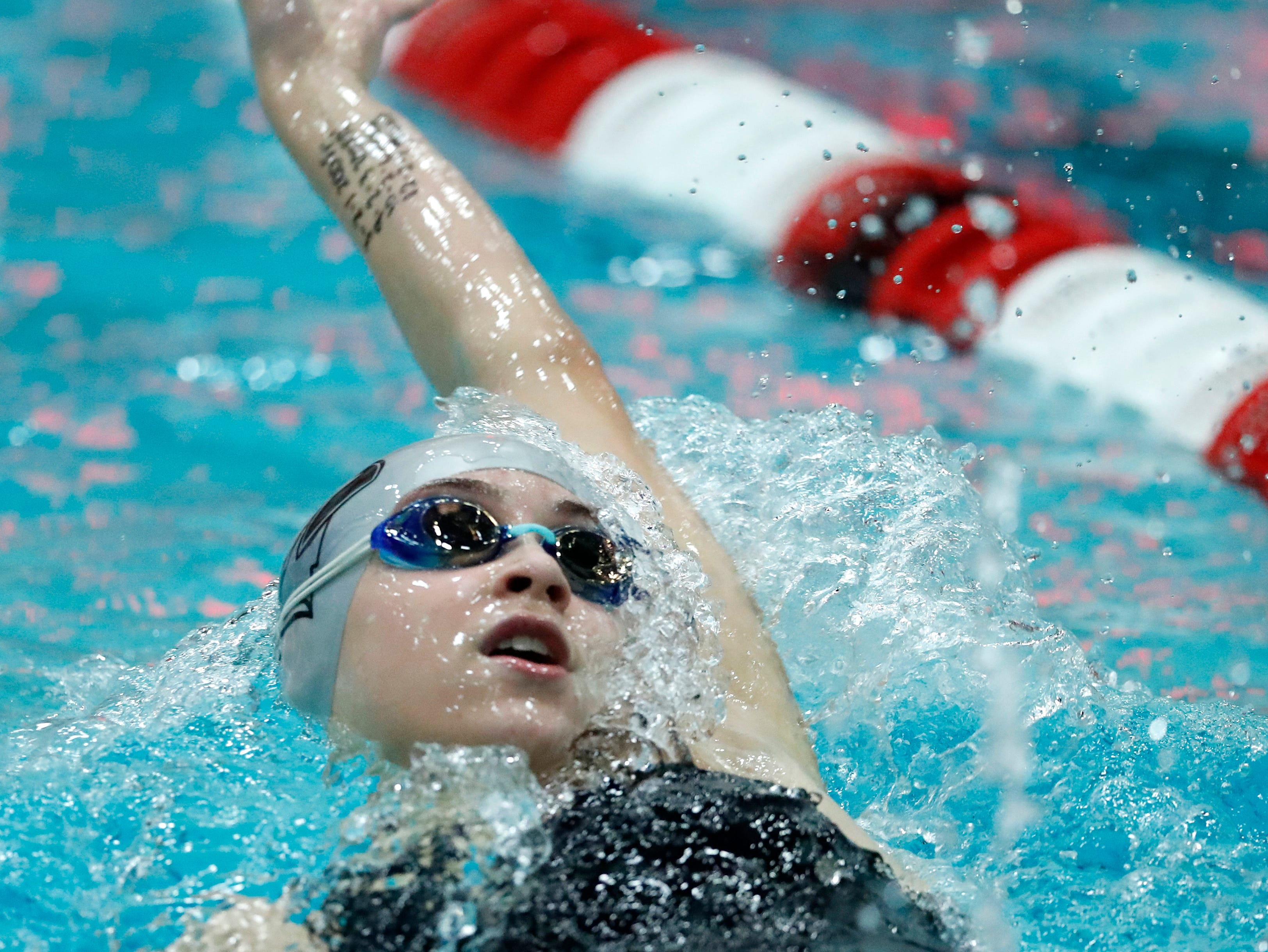 Merrill's Grace Schultz races in the 100 yard backstroke during the WIAA Division 2 State Swimming and Diving meet Friday, Nov. 9, 2018, at the UW Natatorium in Madison, Wis.