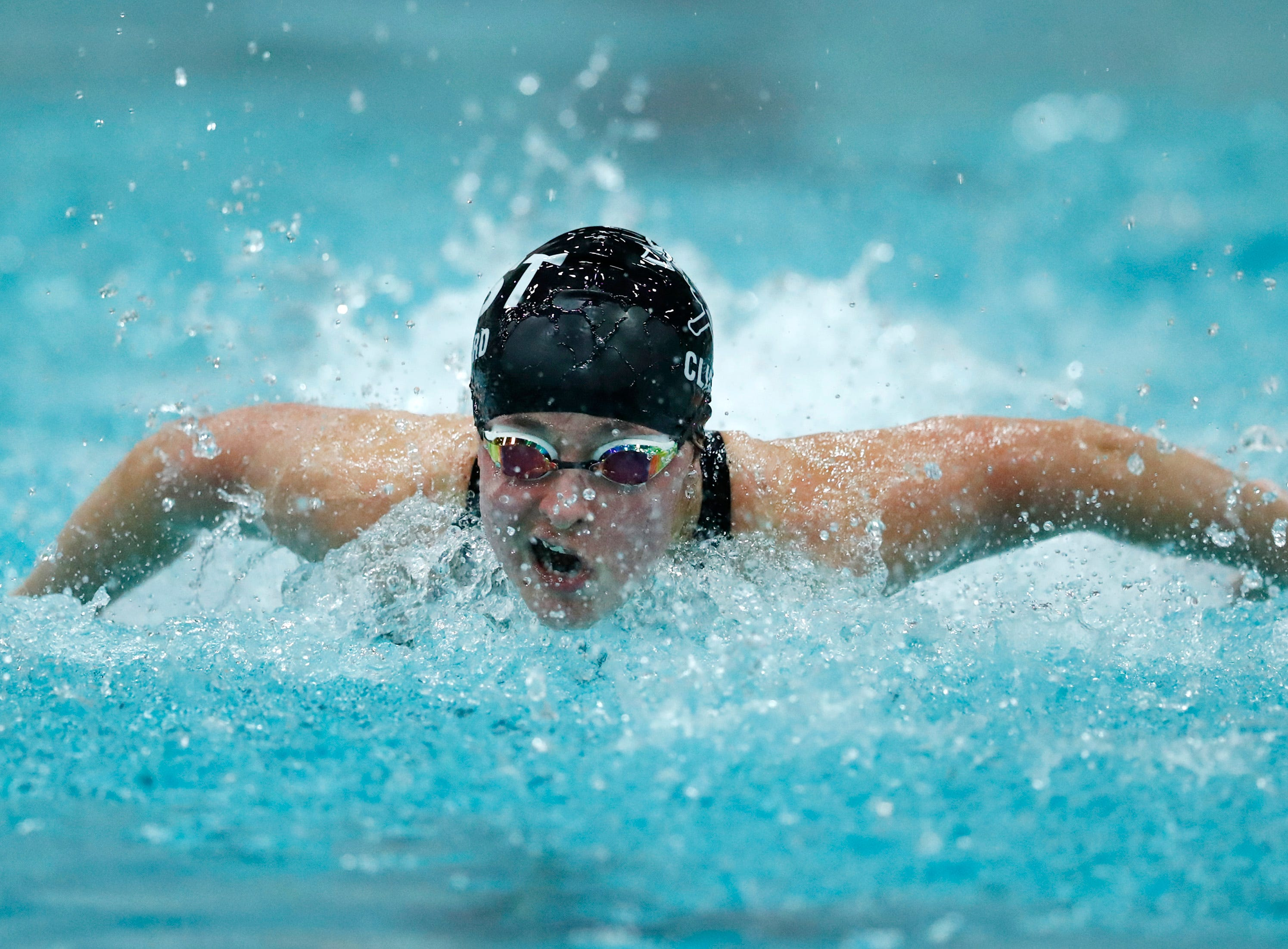 Wausau East's Emma Clifford races in the 100 yard butterfly during the WIAA Division 2 State Swimming and Diving meet Friday, Nov. 9, 2018, at the UW Natatorium in Madison, Wis.