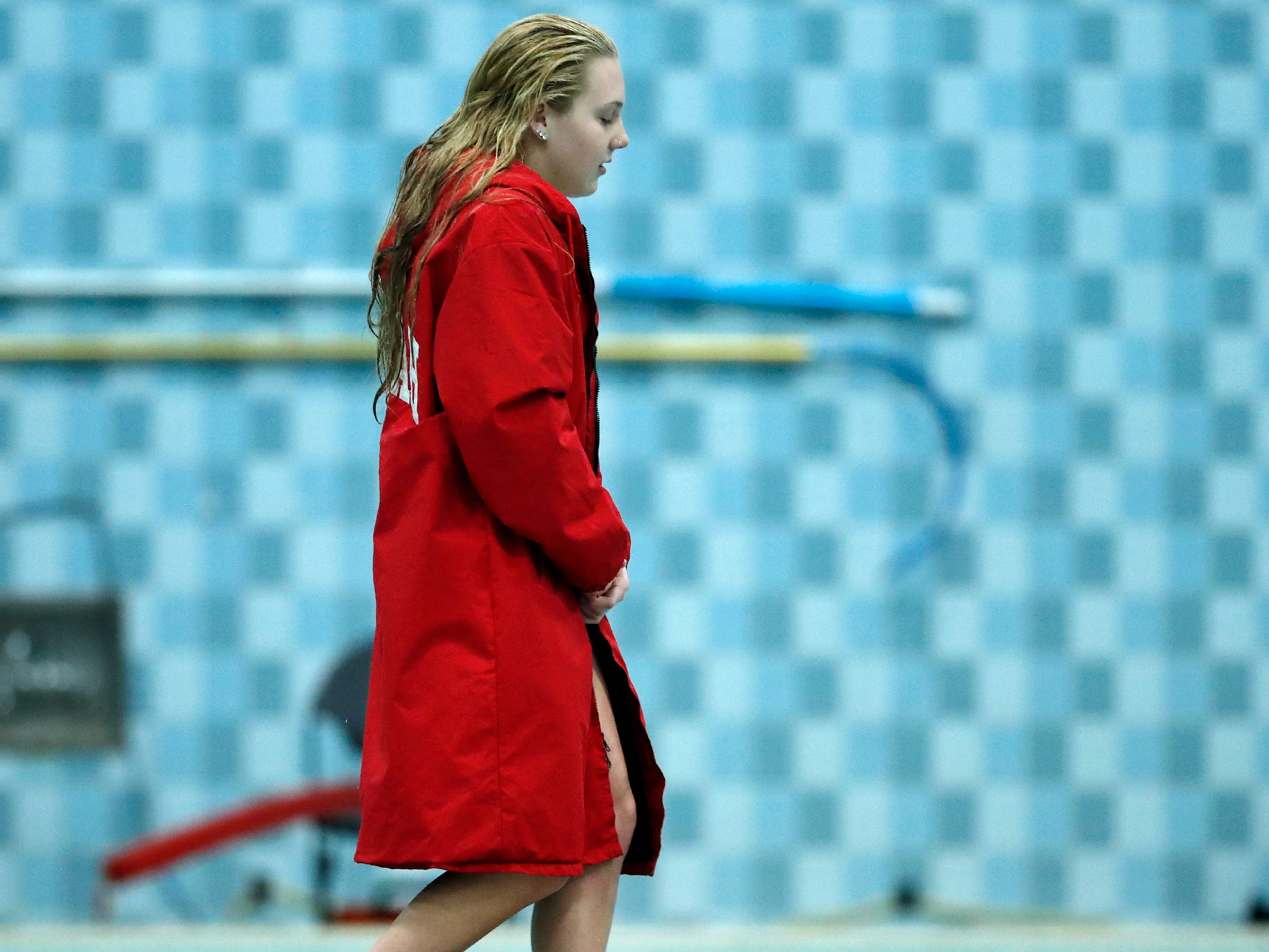 Neenah's Av Osero heads up to the first place podium before accepting her medal after finishing diving during the WIAA Division 1 State Swimming and Diving meet Saturday, Nov. 10, 2018, at the UW Natatorium in Madison, Wis.