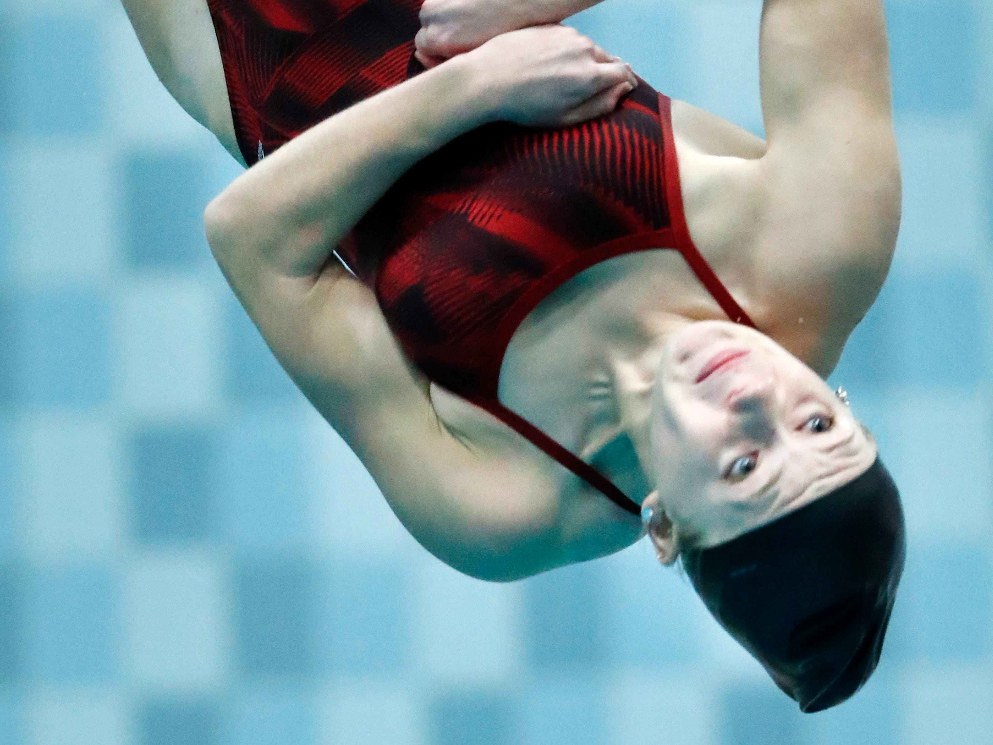 Neenah's Av Osero dives during the WIAA Division 1 State Swimming and Diving meet Saturday, Nov. 10, 2018, at the UW Natatorium in Madison, Wis.