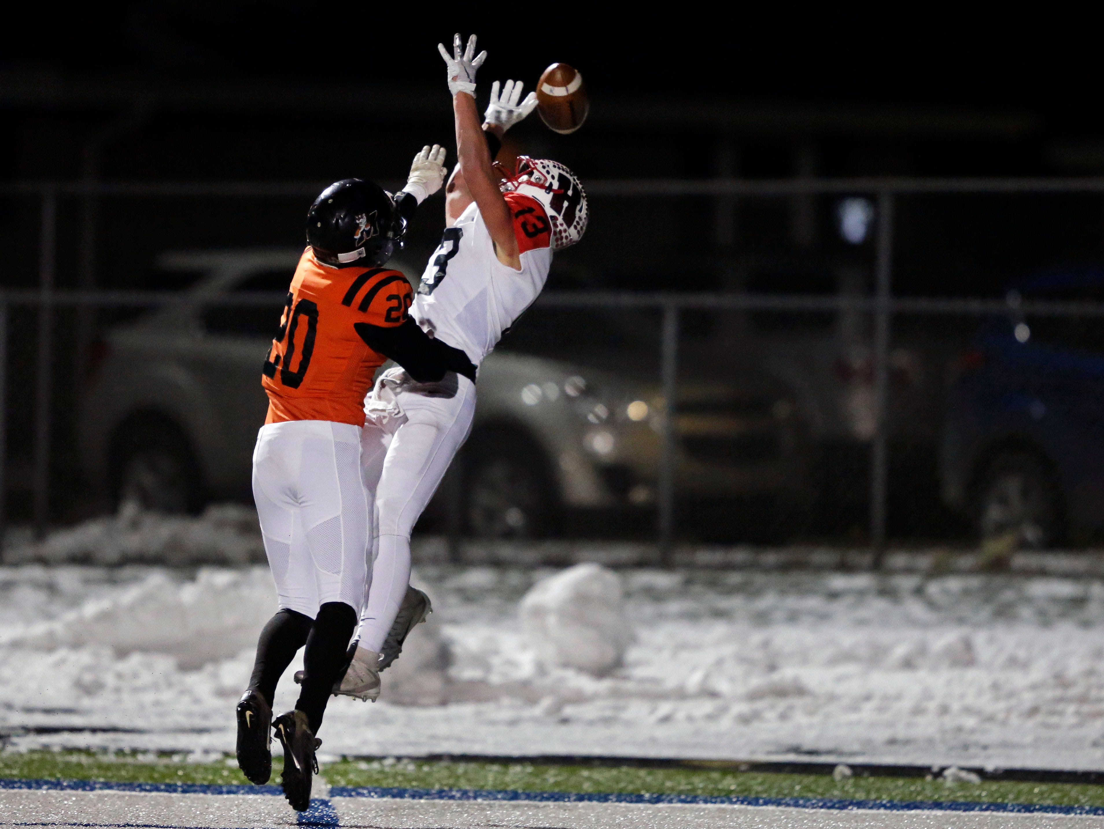 Howie Newbauer of Homestead tries for a pass while being defended by Riley Boushack of Marshfield in a WIAA Division 2 state semifinal football game Friday, November 9, 2018, at Calder Stadium in Menasha, Wis.Ron Page/USA TODAY NETWORK-Wisconsin