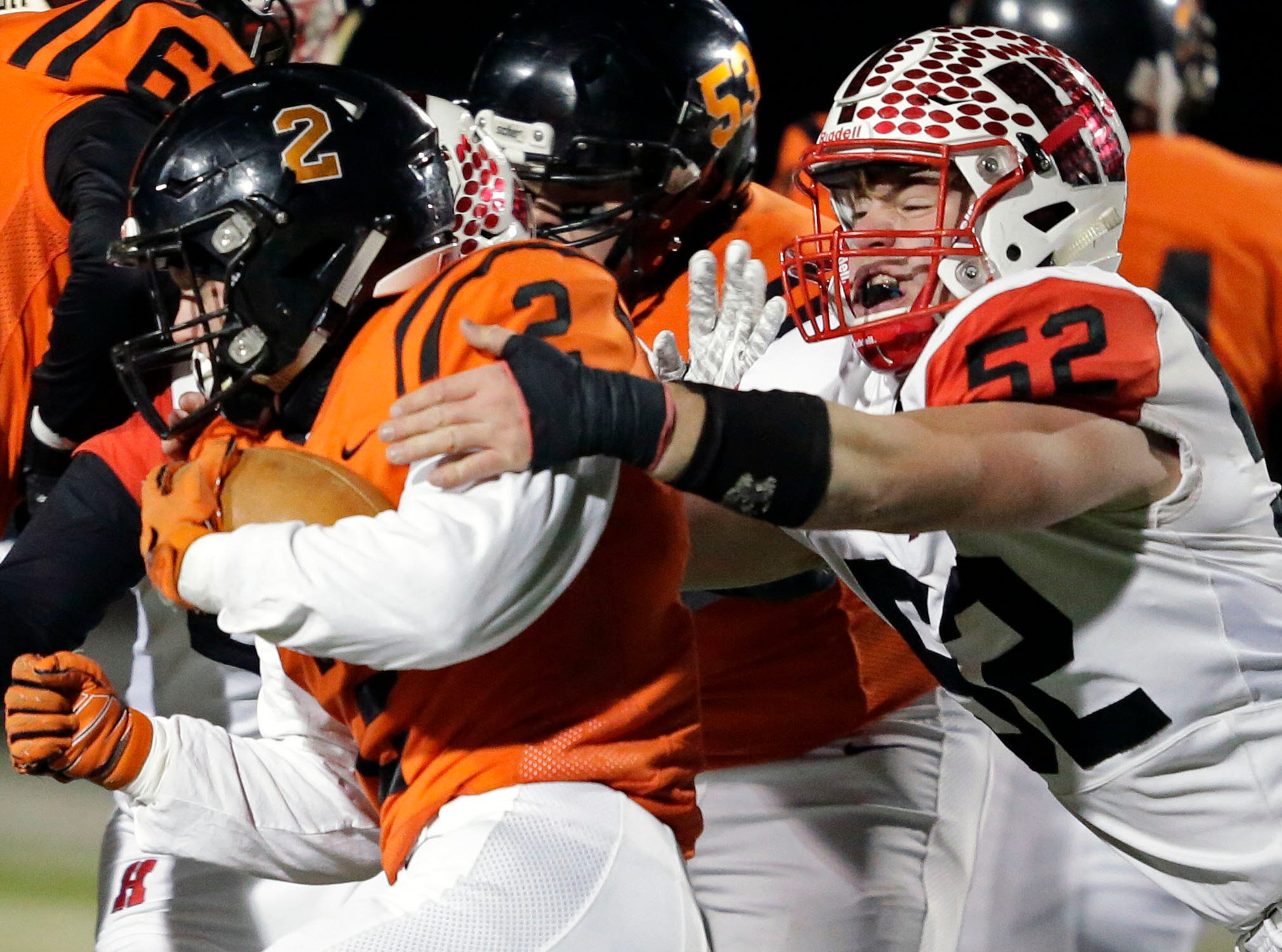 Brant Bohman of Marshfield is tackled by Jake Raddatz of Homestead in a WIAA Division 2 state semifinal football game Friday, November 9, 2018, at Calder Stadium in Menasha, Wis.Ron Page/USA TODAY NETWORK-Wisconsin