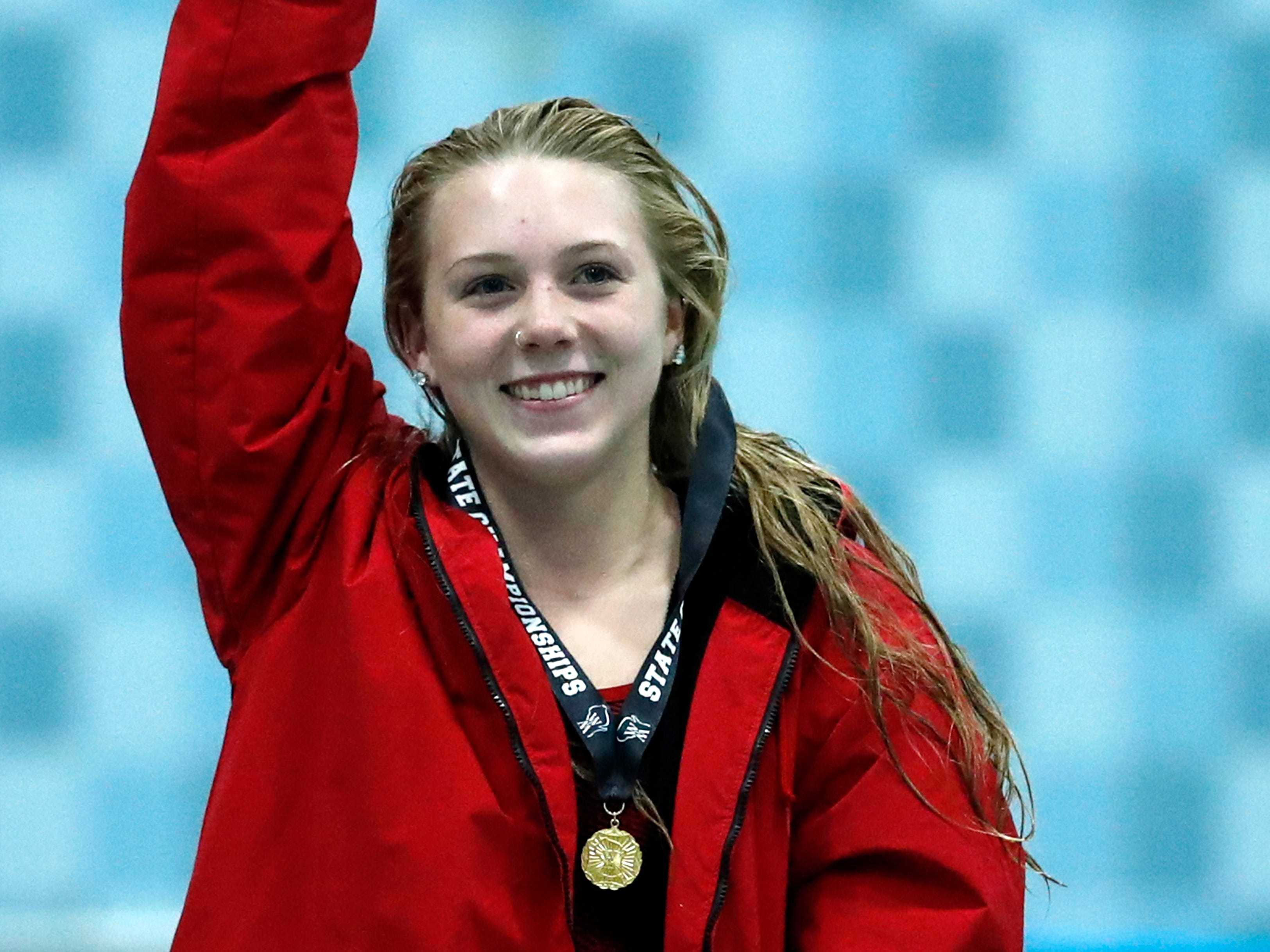 Neenah's Av Osero waves to the crowd after getting first place in the diving competition during the WIAA Division 1 State Swimming and Diving meet Saturday, Nov. 10, 2018, at the UW Natatorium in Madison, Wis.