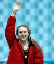 Neenah's Av Osero waves to the crowd after getting first place in the diving competition during the WIAA Division 1 State Swimming and Diving meet Nov. 10 at the UW Natatorium in Madison.