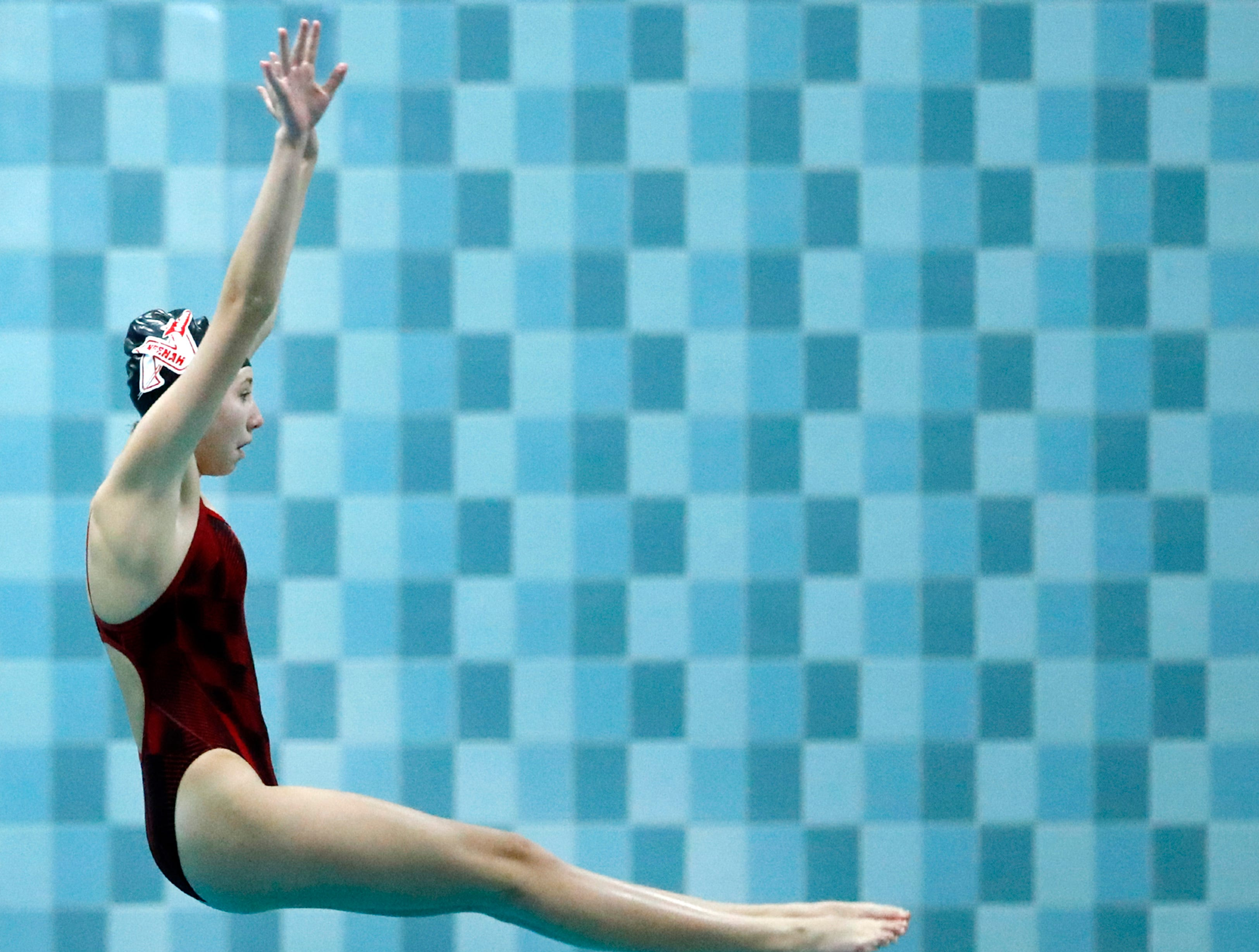 Neenah's Bailey Schroeder dives during the WIAA Division 1 State Swimming and Diving meet Saturday, Nov. 10, 2018, at the UW Natatorium in Madison, Wis.