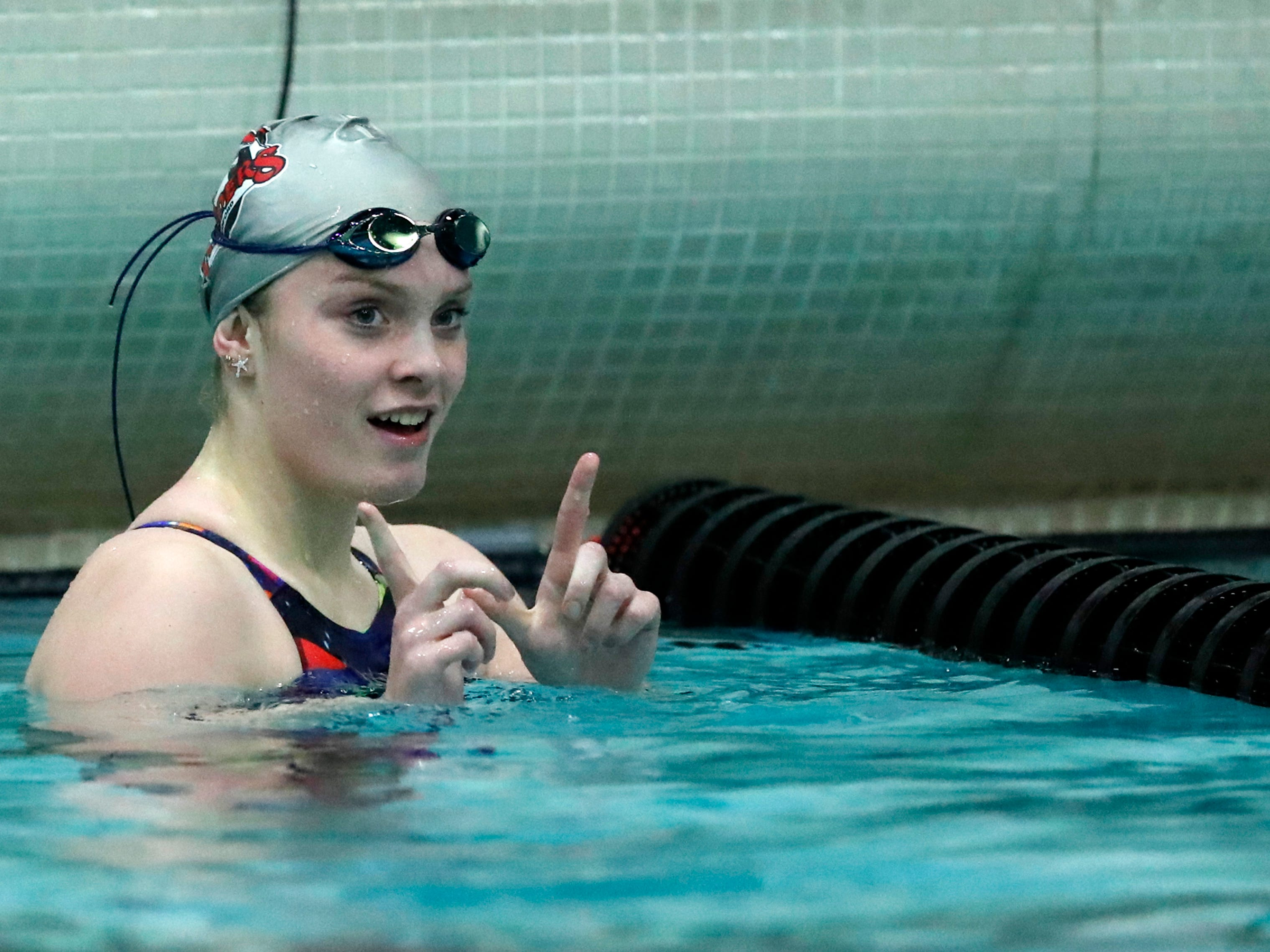 Medford's Erin Bergman signals to her team after finishing the 200 yard freestyle during the WIAA Division 2 State Swimming and Diving meet Friday, Nov. 9, 2018, at the UW Natatorium in Madison, Wis.