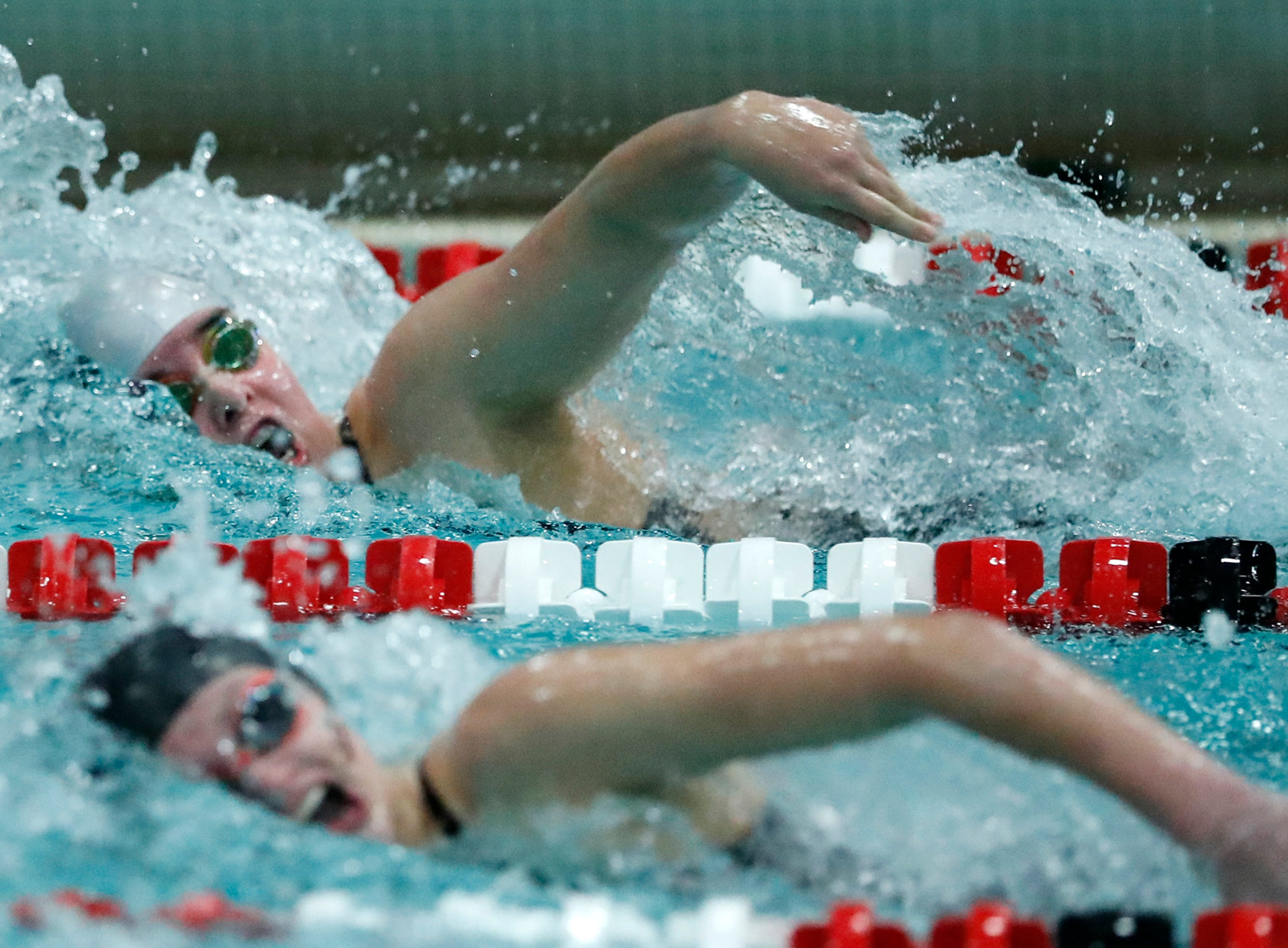 Merrill's Claire Schultz races in the 100 yard freestyle during the WIAA Division 2 State Swimming and Diving meet Friday, Nov. 9, 2018, at the UW Natatorium in Madison, Wis.