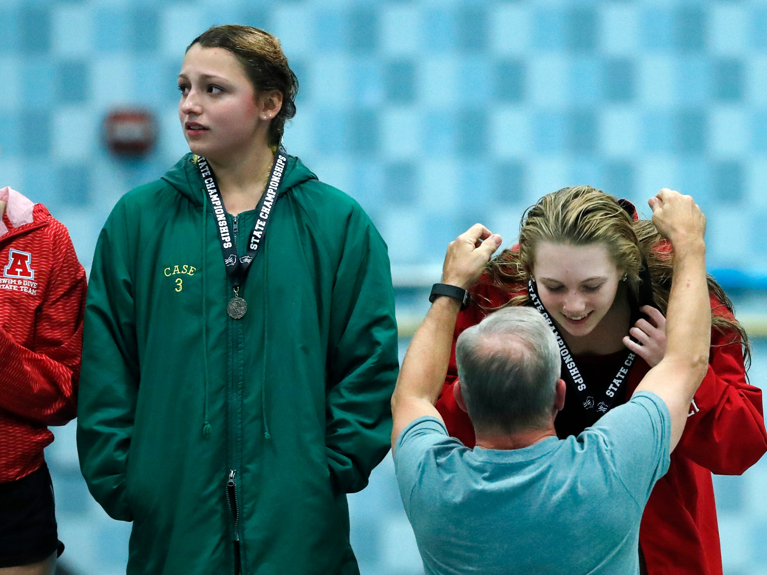 Neenah's Av Osero gets her first place medal after finishing diving during the WIAA Division 1 State Swimming and Diving meet Saturday, Nov. 10, 2018, at the UW Natatorium in Madison, Wis.